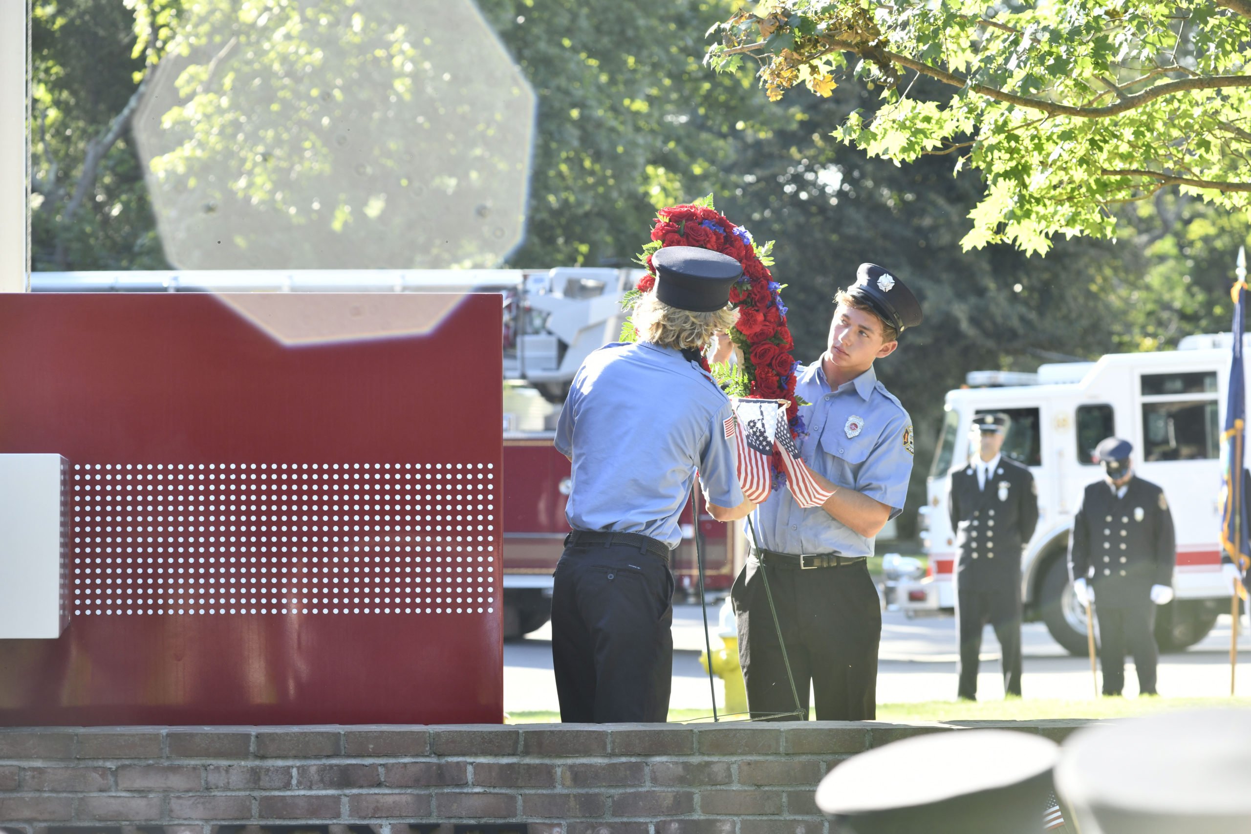 Members of the Southampton Fire Department Juniors lay the wreath at the memorial.