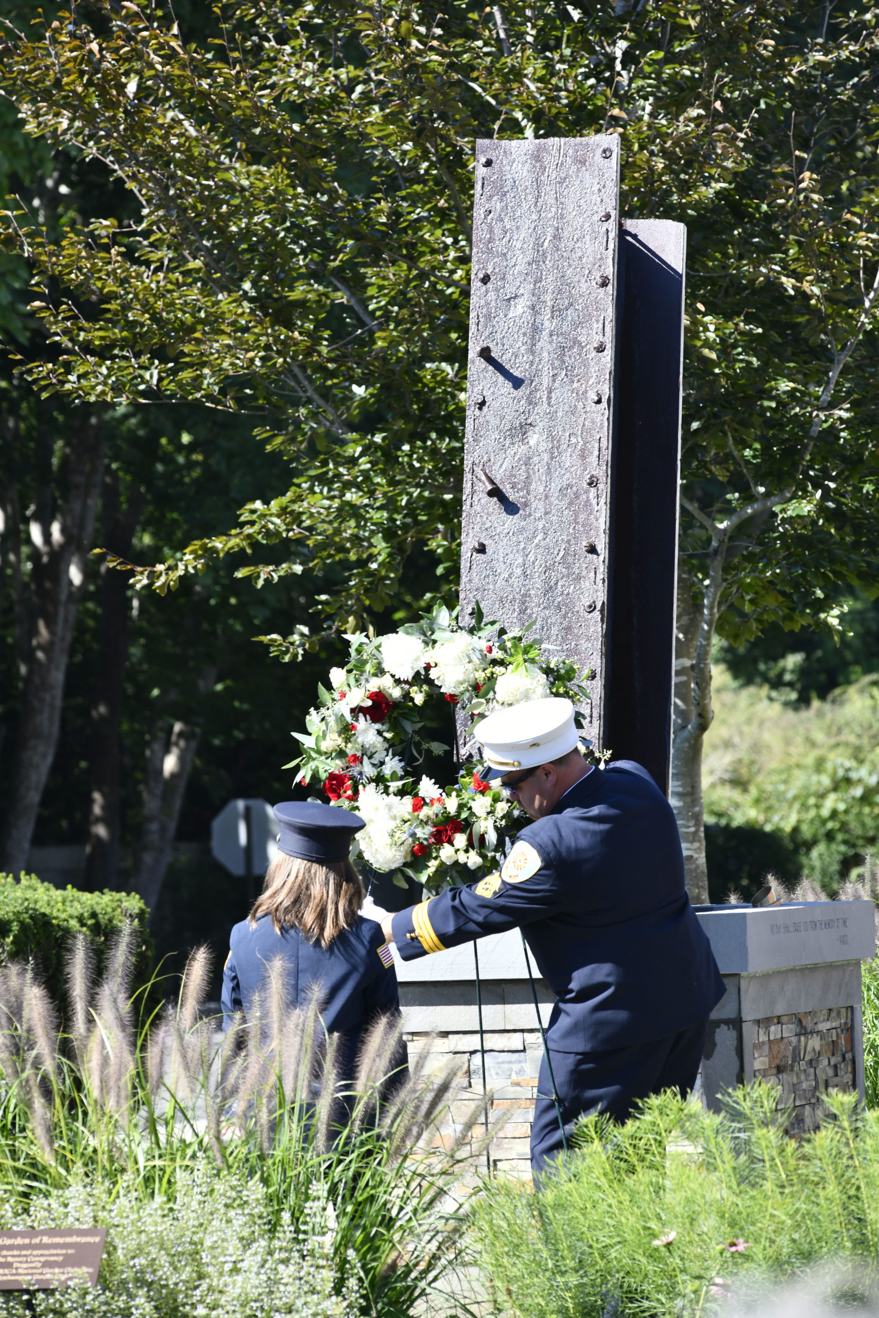 The wreath is laid at the rededication of the Quogue 9/11 Memorial on Saturday.