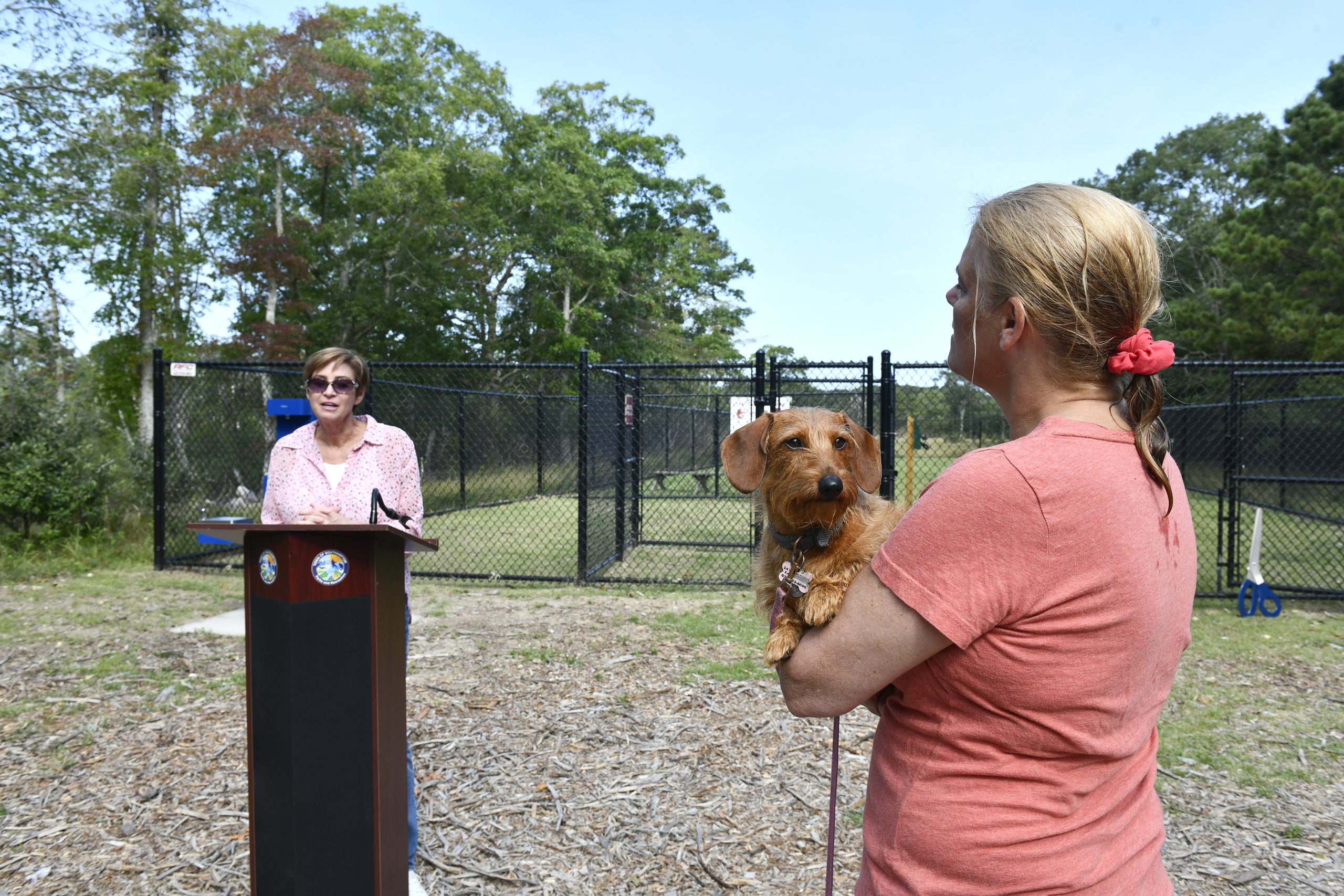 Southampton Town Councilwoman Julie Lofstad welcomes guests to the opening of he Off the Leash Dog Park in East Quogue on Monday morning. The park is located at Pine Neck Marina, 22 Josiah Foster Path in East Quogue.   DANA SHAW