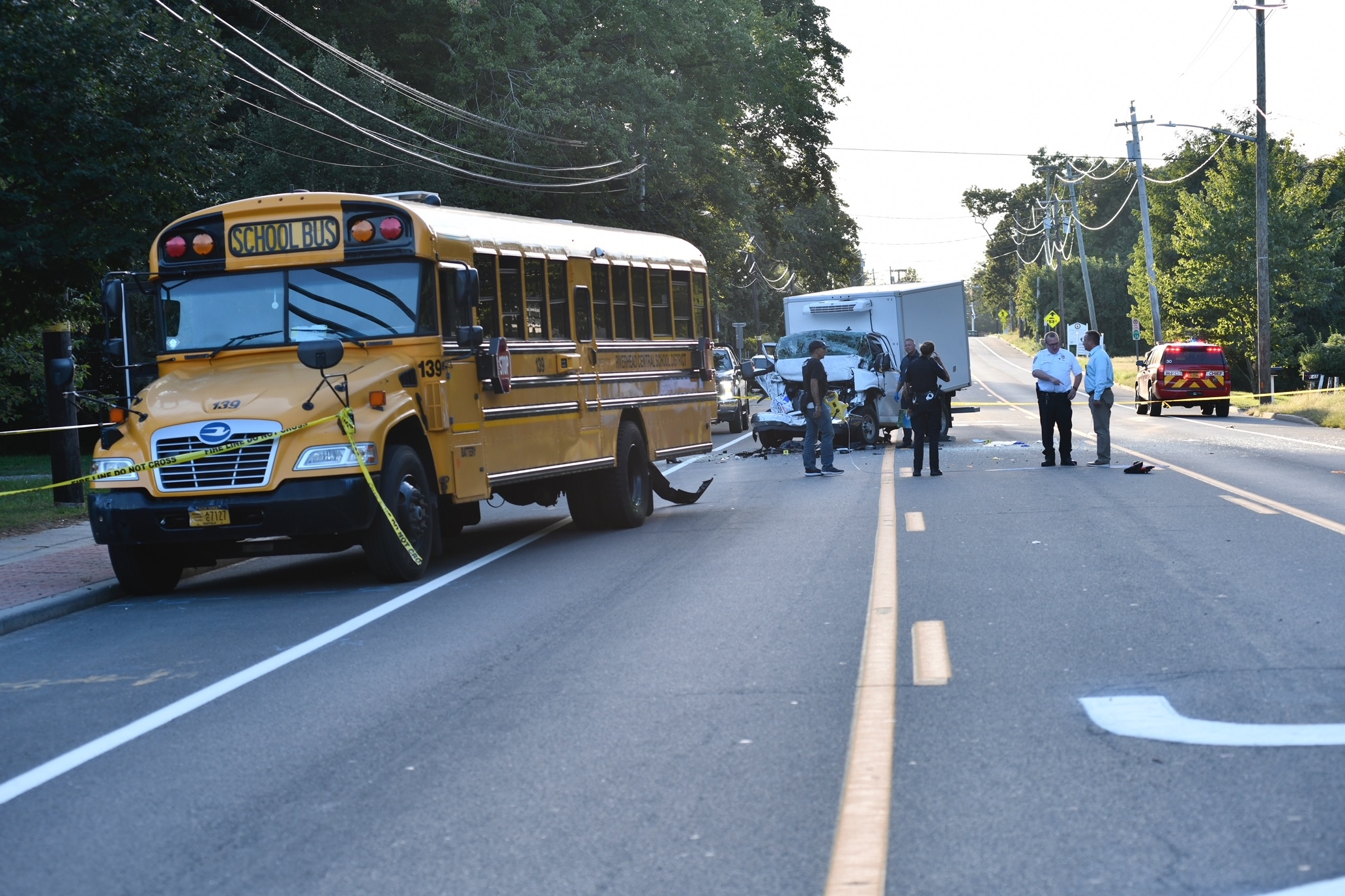 A collision involving a school bus and a box truck  in Riverside on Monday afternoon closed Flanders Road for hours.