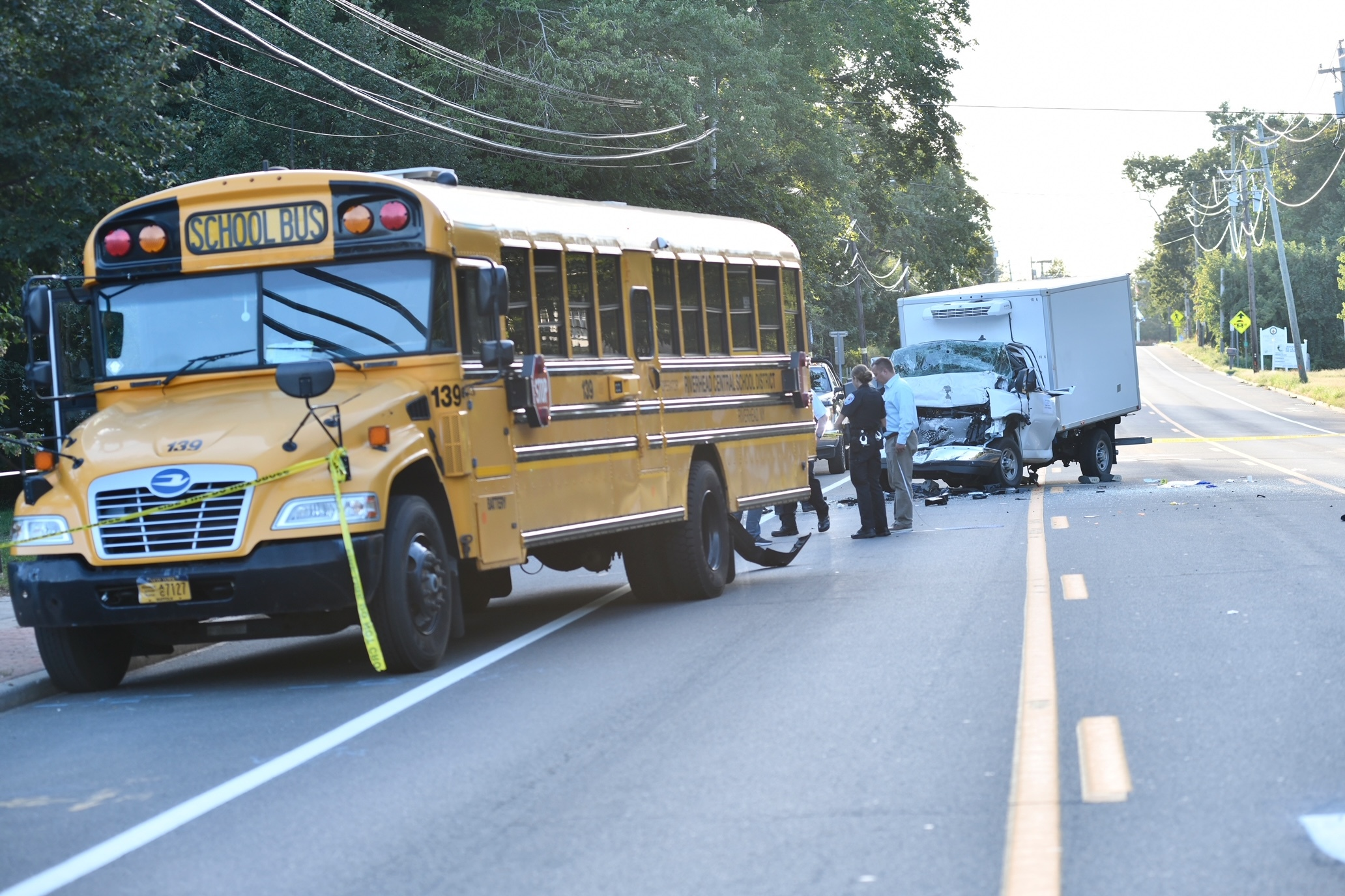 A box truck rear-ended a school bus on Flanders Road on Monday afternoon.