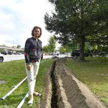 Southampton Village Trustee at the location of a new electric vehicle charging station at Rail Road Plaza.   DANA SHAW