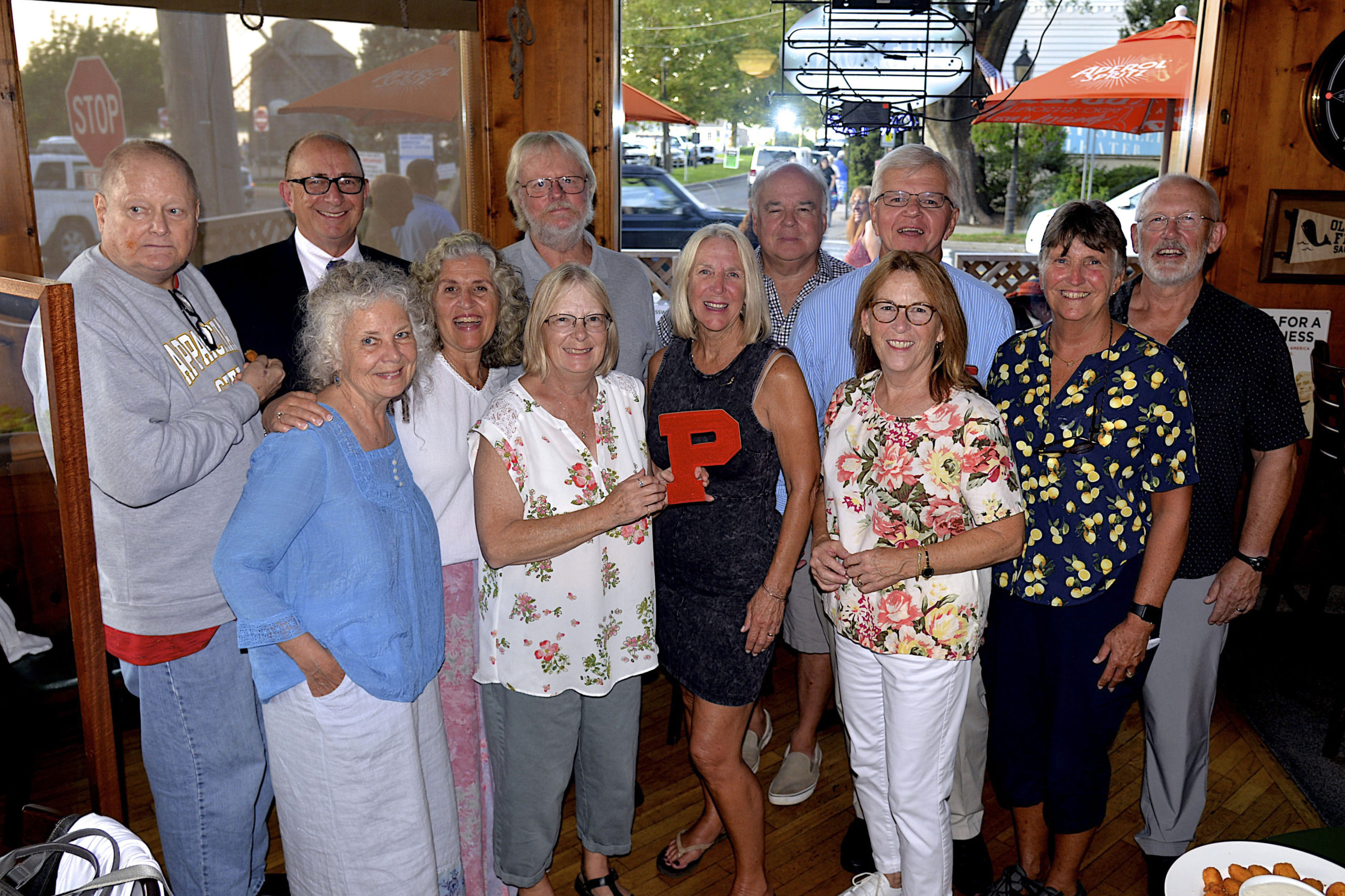 Some of the members of the Pierson Class of 1971, Michael Remkus, Steve Haerter, Marion Allen, Cathy Santacroce-Worwetz, Harold Worwetz, Colleen Stafford, Beth O'Sullivan, Tim Mott, Fred Thiele, Vee Bennett, Bethany Deyermond and Mark Weiderst, met at the Corner Bar in Sag harbor on Saturday evening to celebrate their 50th reunion.    KYRIL BROMLEY