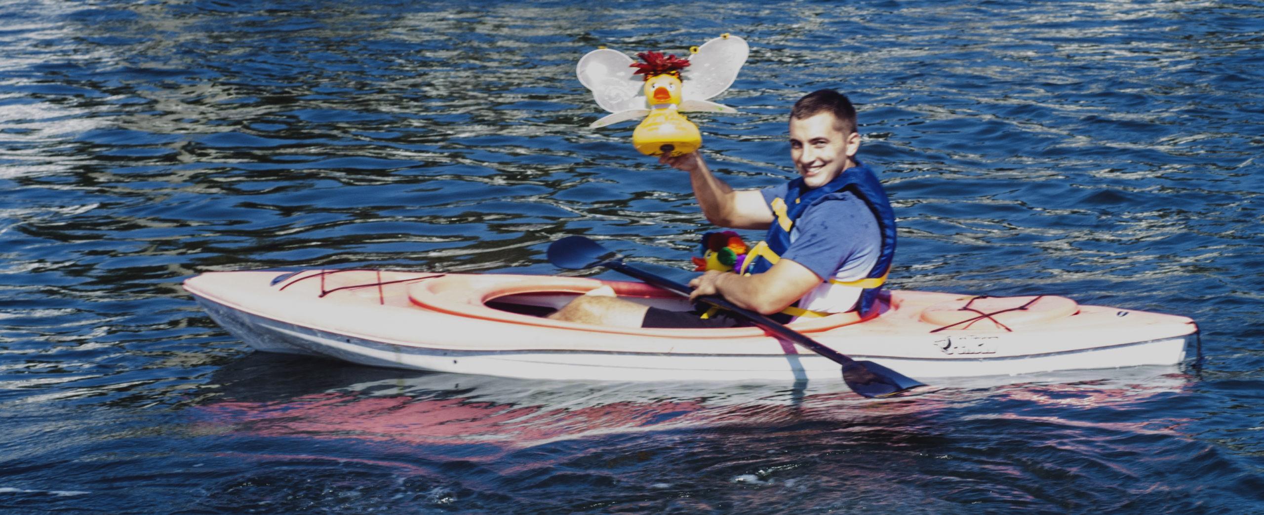 Duck wrangler J.J. holds high the duck race proud winner.  COURTESY HAMPTON BAYS CIVIC ASSOCIATION