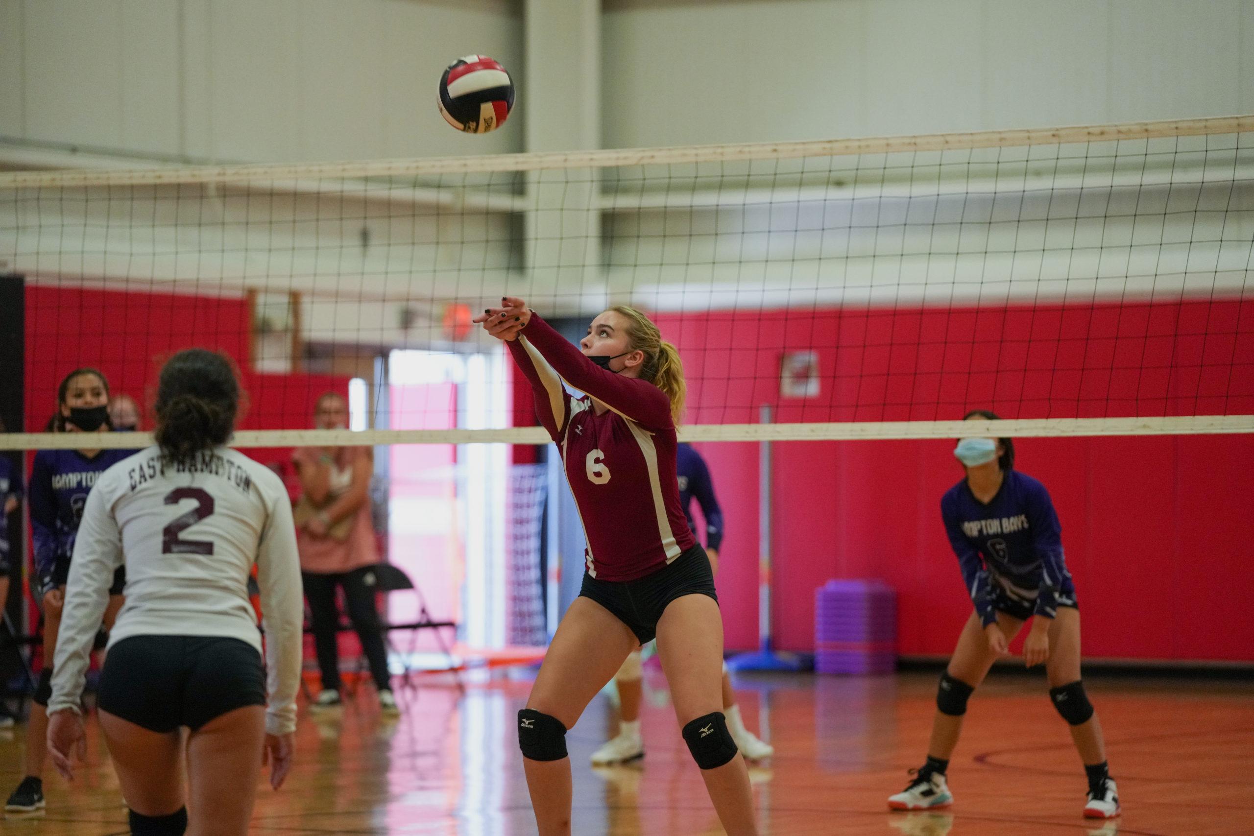 East Hampton senior Faith Fenelon sets the ball.