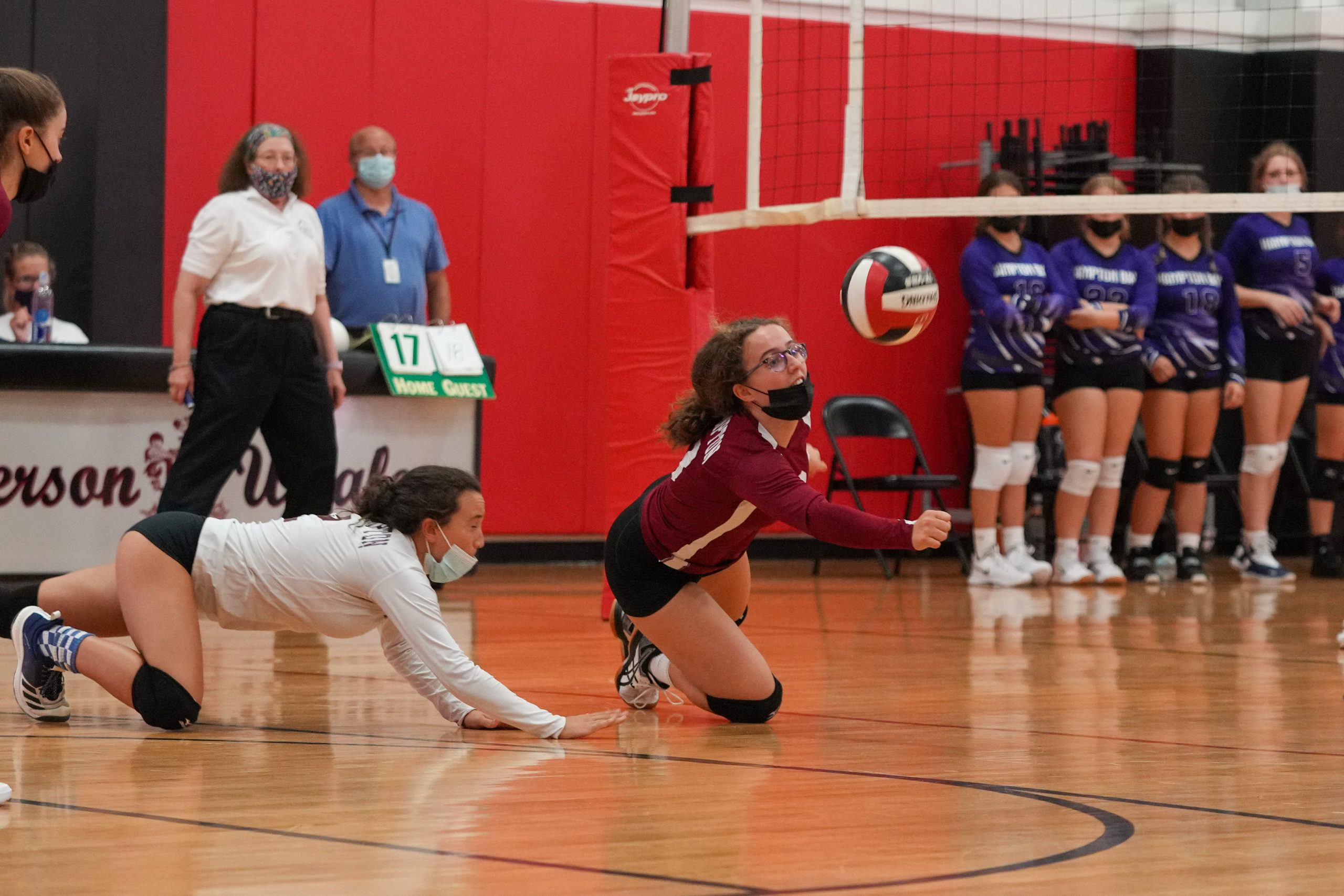 An East Hampton player dives for the ball.