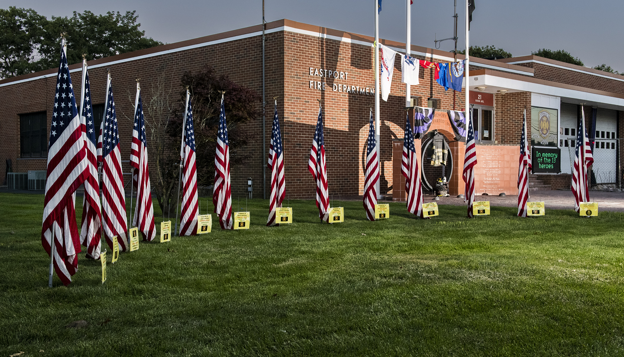Members of the Eastport Fire Department installed a flag display in front of its firehouse last week. The display honors the one U.S. Navy sailor, one Army soldier, and 11 U.S. Marines killed protecting Americans and Afghan allies in Kabul last week.