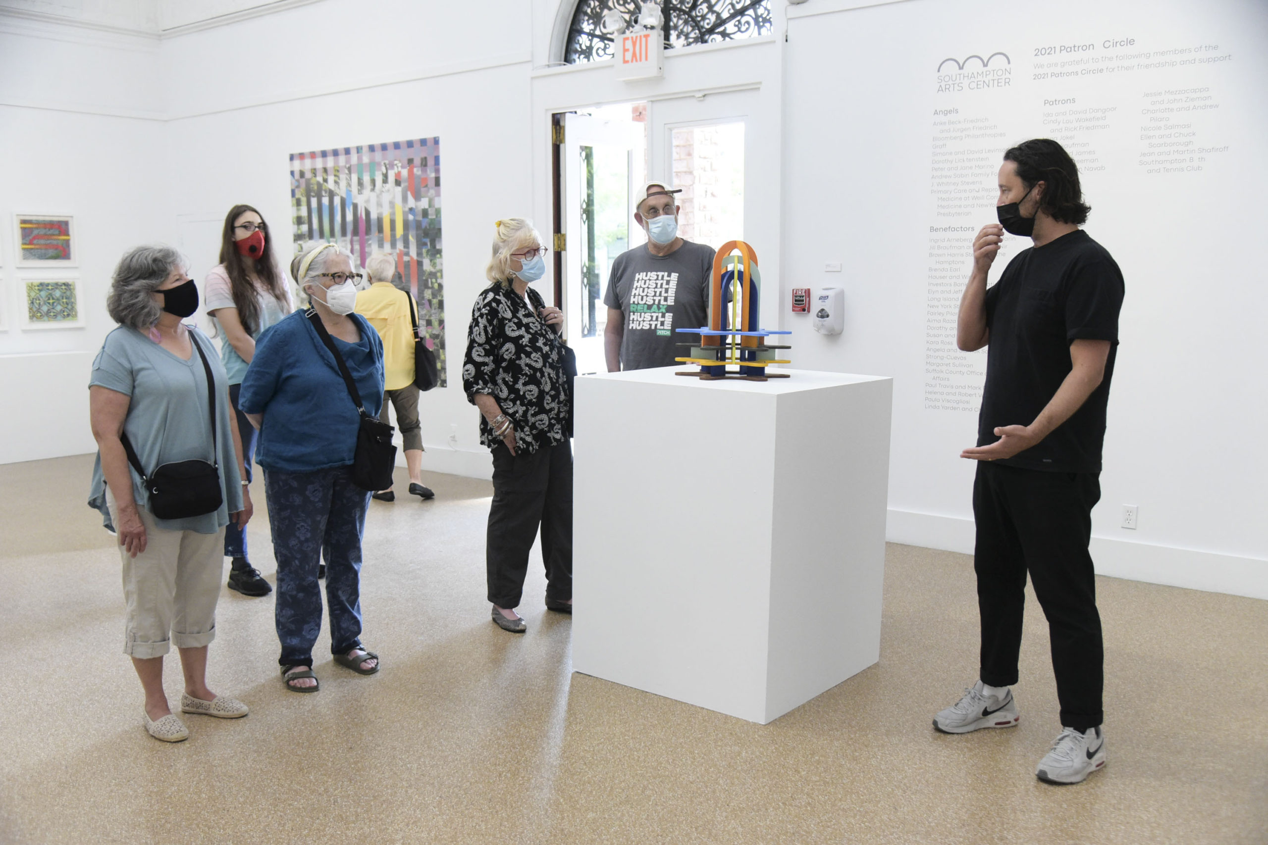Curator Jay Davis leads a tour of
