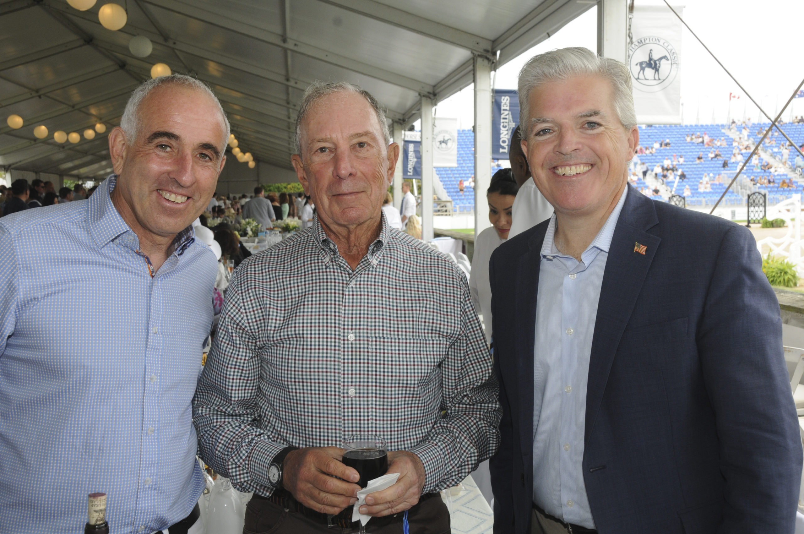 Jay Schneiderman, Michael Bloomberg and Steve Bellone in the tent at the Hampton Classic Grand Prix on Sunday afternoon.   RICHARD LEWIN