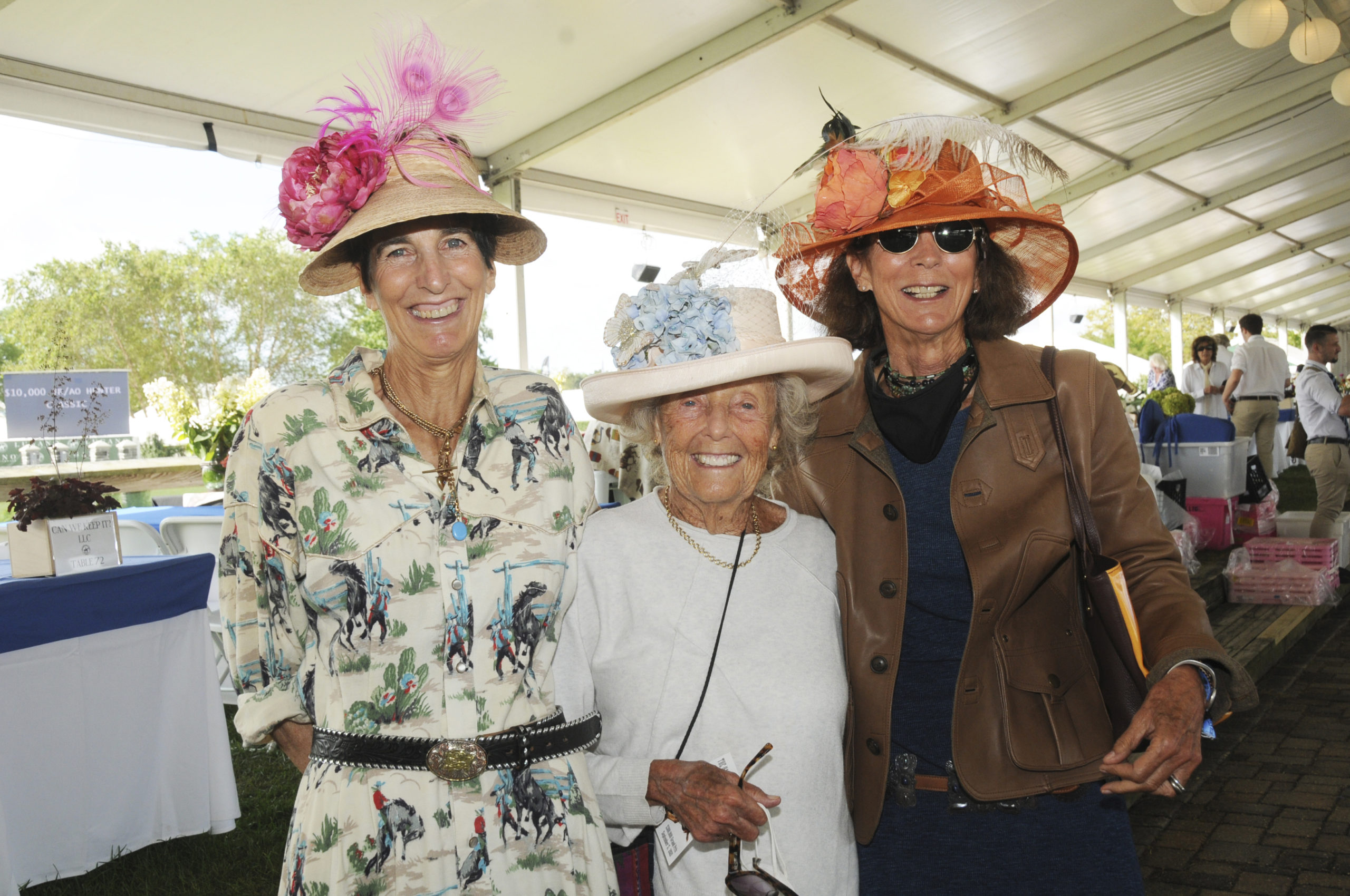 Nancy Banfield, Tinka Topping and Sue Ellen O'Connor in the tent at the Hampton Classic Grand Prix on Sunday afternoon.   RICHARD LEWIN