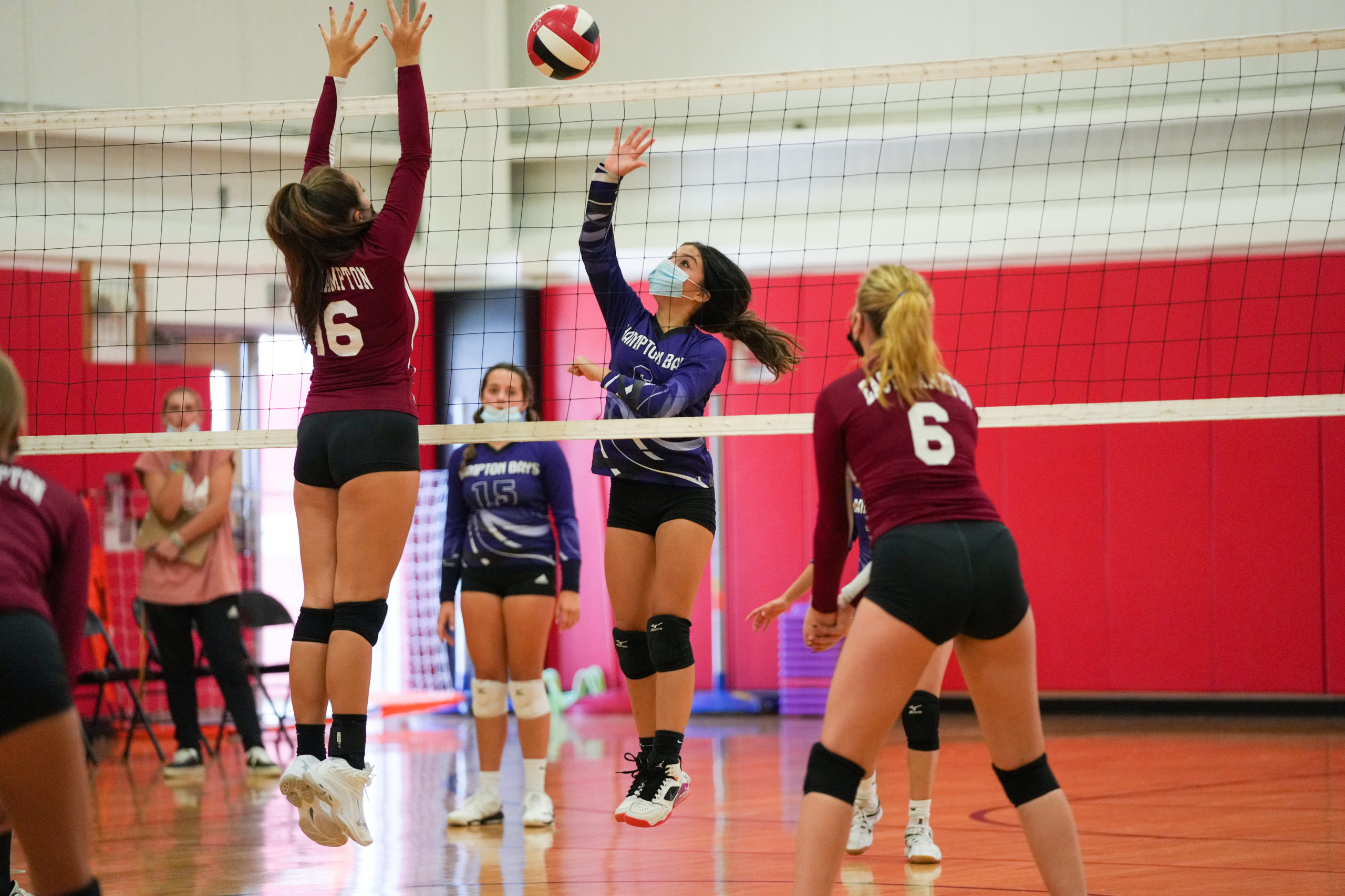 Alex Rojas of Hampton Bays looks to get the ball over the net.