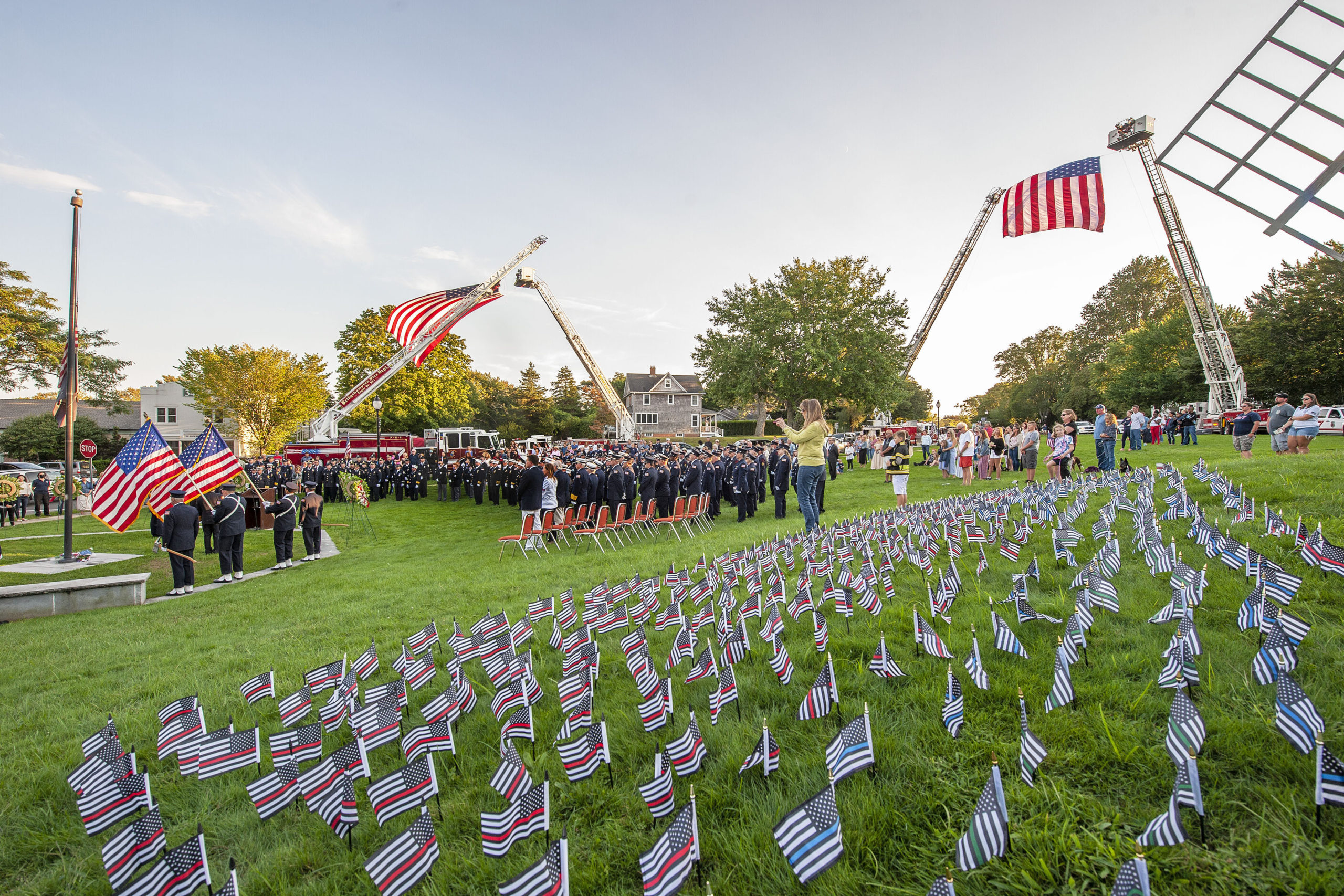 Individual flags for every member of the fire, police or military who died at 9/11 were  laid out during a ceremony commemorating the 20th anniversary of the attack on the World Trade Center, held on the Village Green in East Hampton and attended by 11 different East End fire, police and EMS agencies on Saturday afternoon.