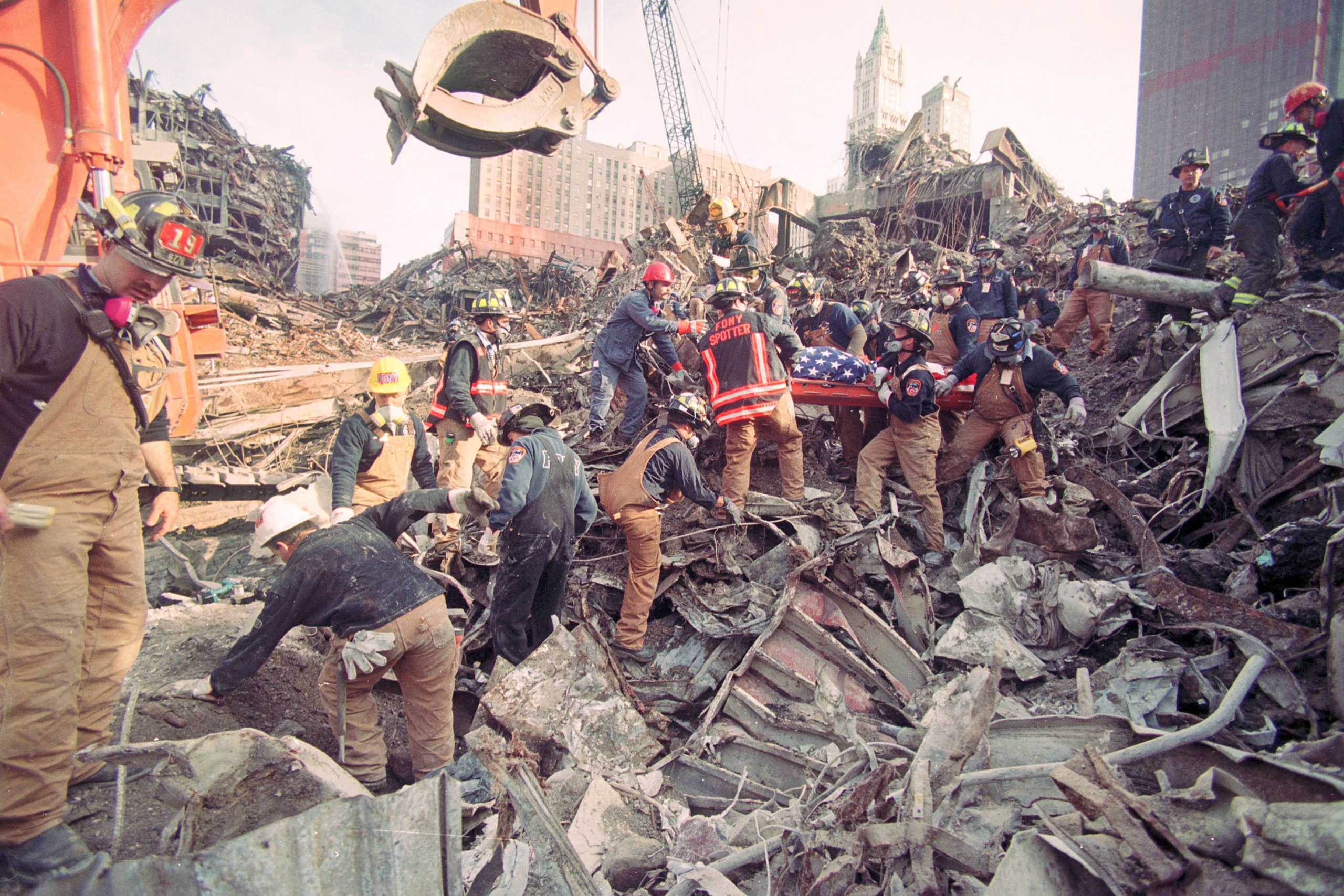 December of 2001-- the FDNY and other rescue workers recovering the body of a FDNY firefighter they had come upon while excavating the remains of the towers.    MICHAEL HELLER
