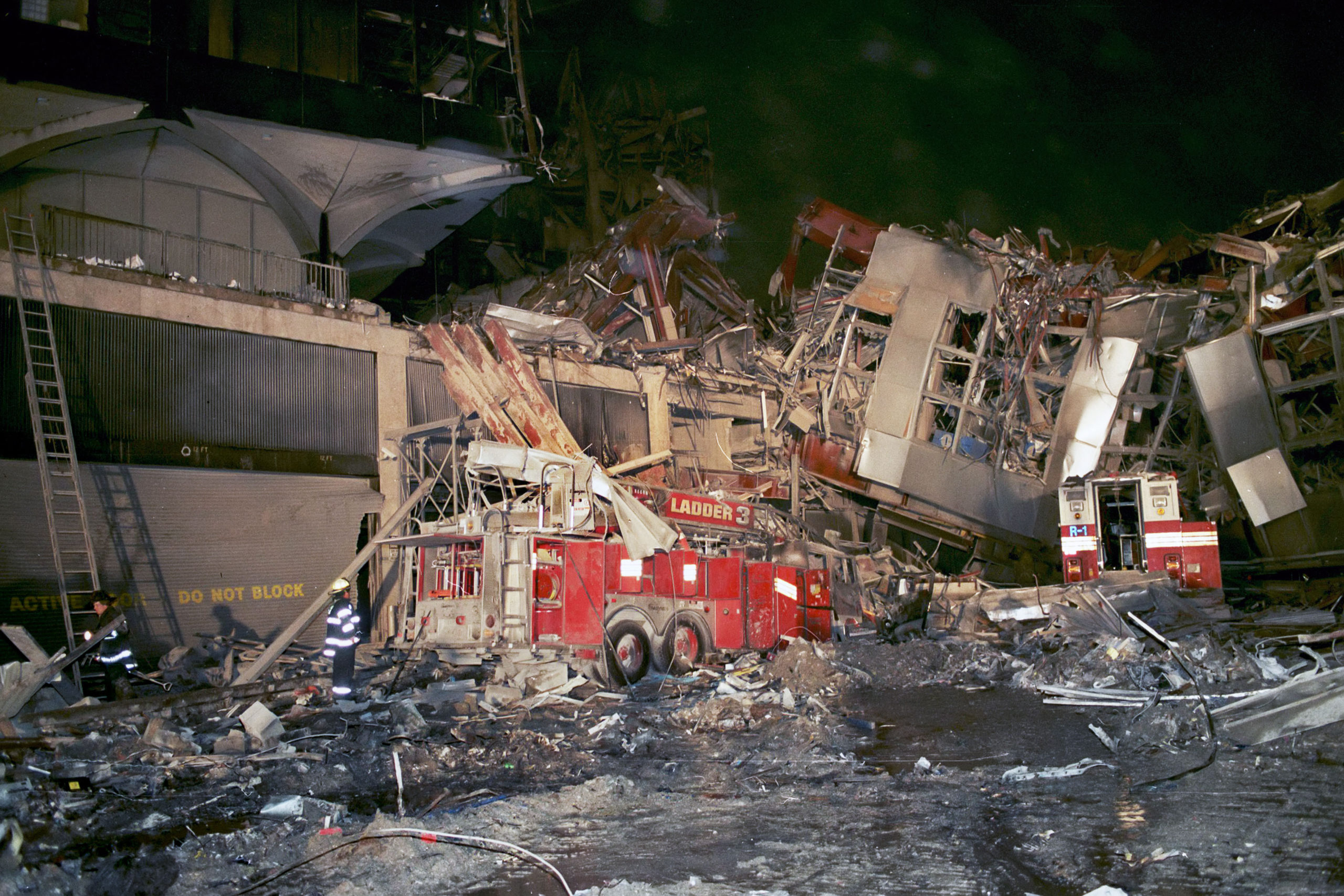 The remains of FDNY Ladder 3,FDNY Rescue 1 can also be seen at right. Photo was taken looking southeast from the main staging area at that time, which was at the intersection of West Drive and Barclay Street.   MICHAEL HELLER