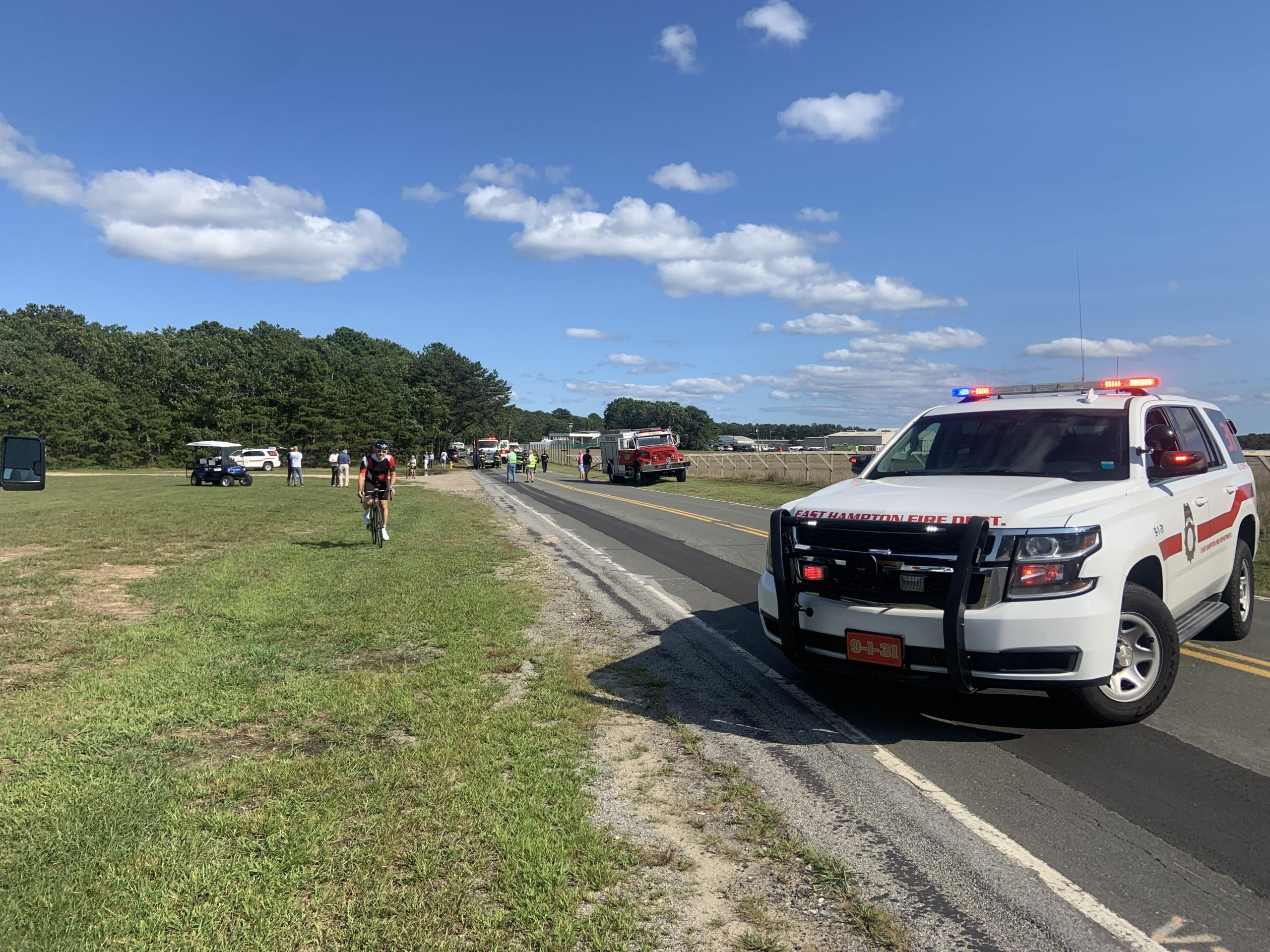The scene on Daniel's Hole Road in East Hampton Friday afternoon after a small plane overshot the runway at East Hampton Airport, crashed through a fence, and came to a rest across the road. Nobody was injured in the mishap. STEPHEN J. KOTZ
