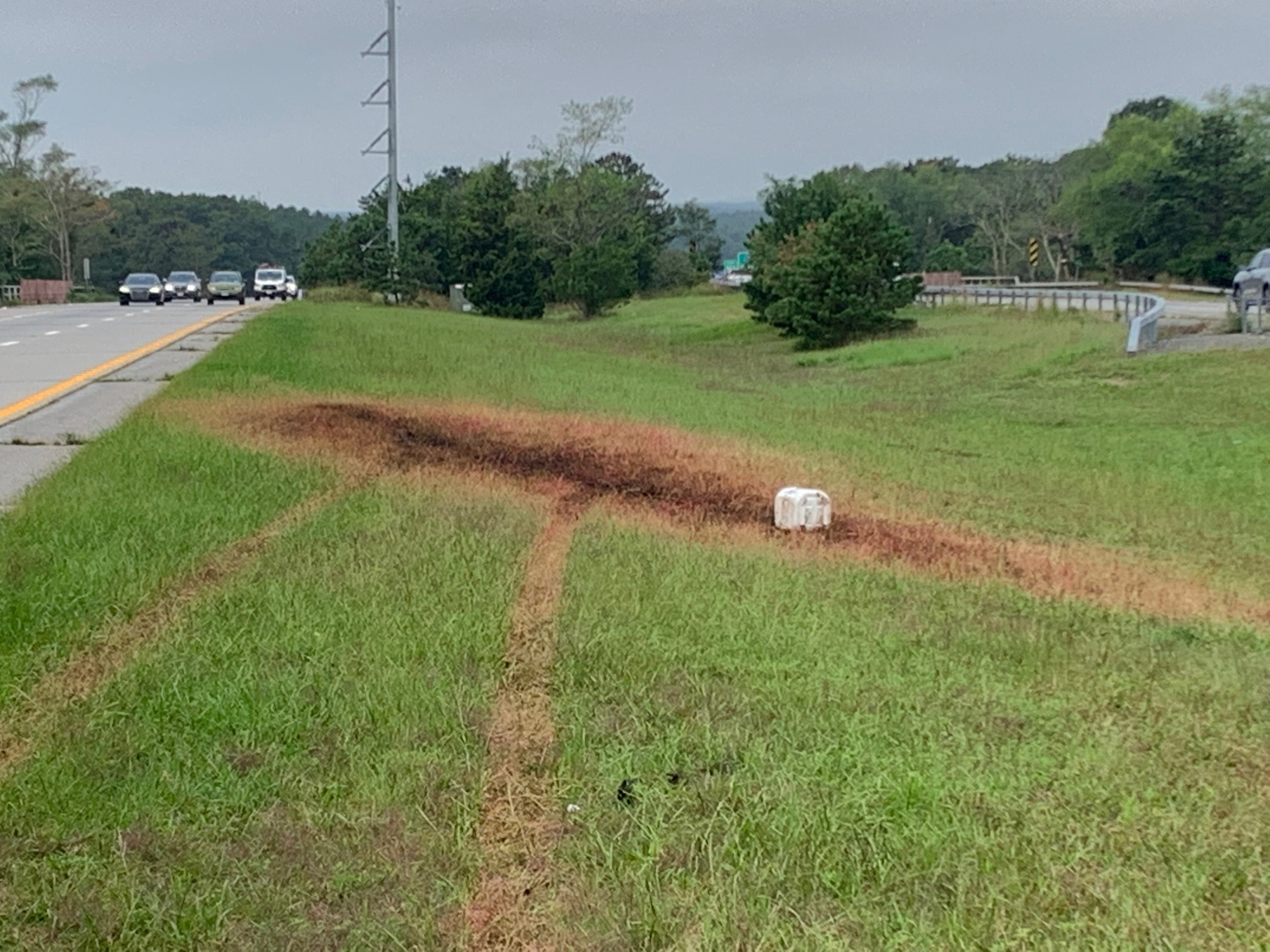 A chemical spill burned a swatch of grass on the shoulder of Sunrise Highway, closing one of its lanes Wednesday morning.