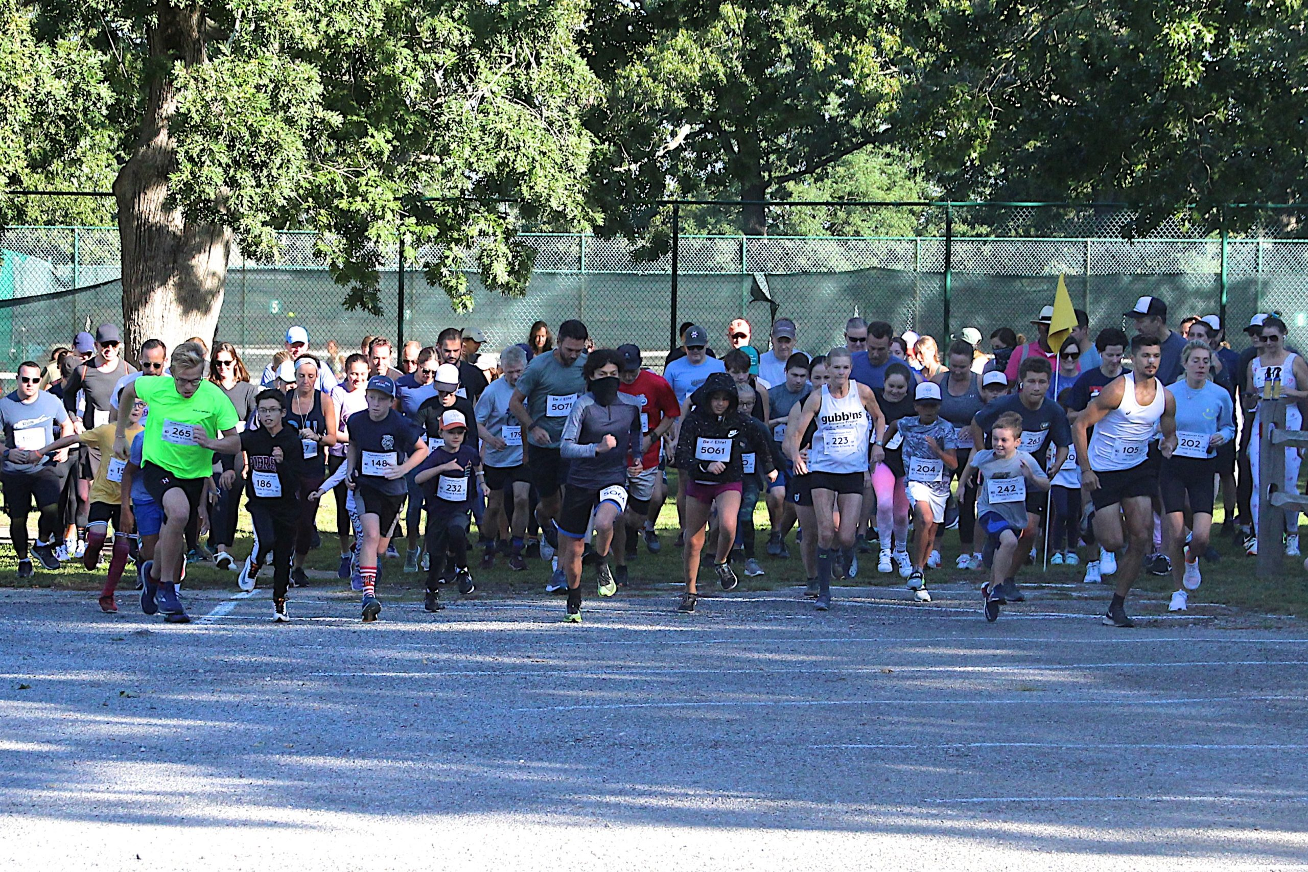 Runners start the inaugural Runners enjoy the first ever Mashashimuet Park Friends and Family 5K Run Saturday morning in Sag Harbor.