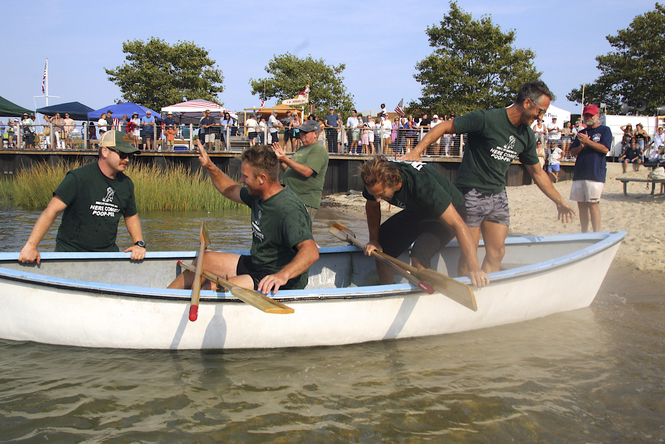 The champion men's whaleboat team from John K. Ott Cesspool Services included, from left to right, Jeff Greenwald, Brian O'Sullivan, Pete Finelli, Eric Bramoff and Kevin O'Brien Jr.   KYRIL BROMLEY