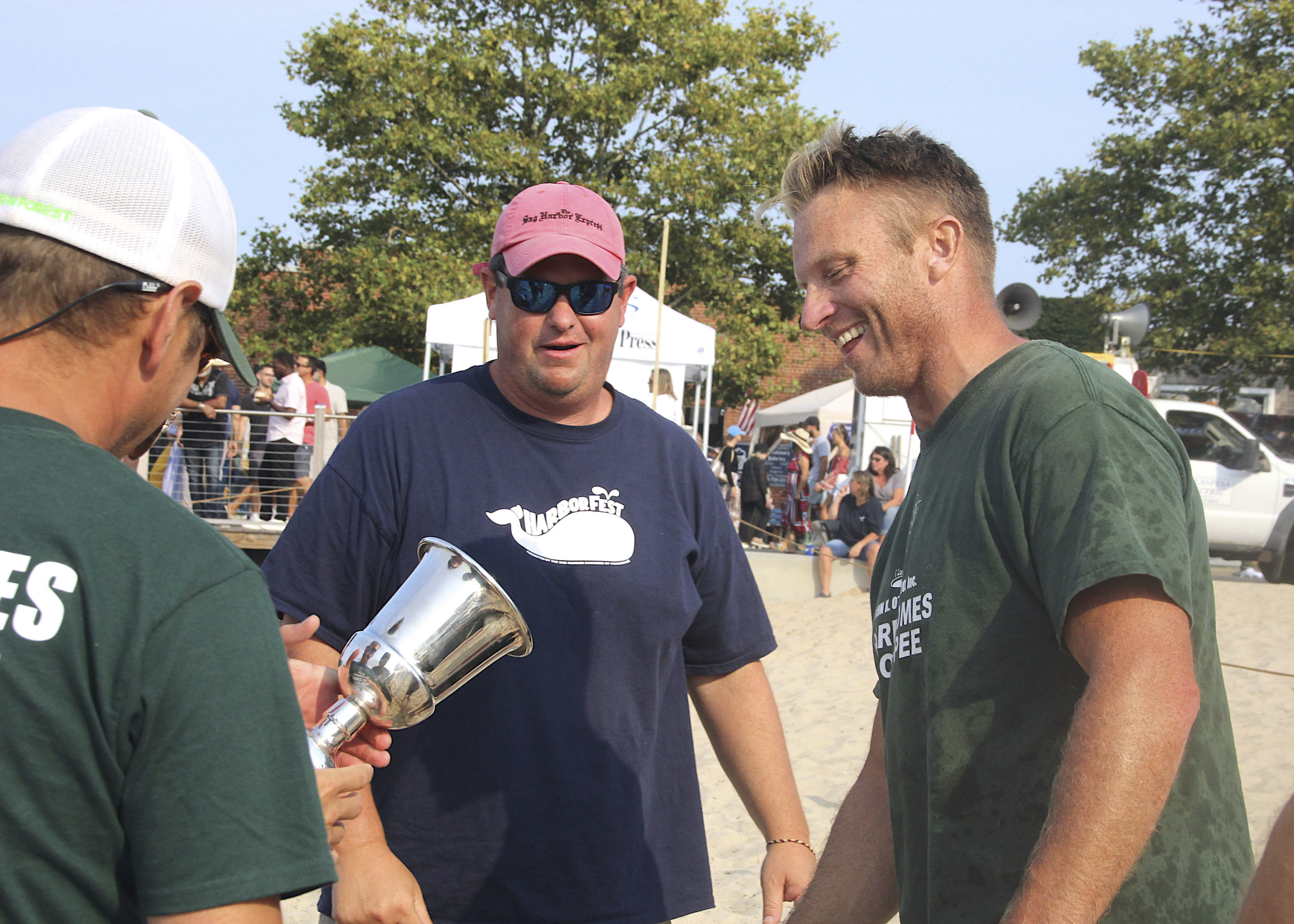 Eric Bramoff, the Sag Harbor School District athletic director, reaches for the Whalers Cup after leading his John K. Ott Cesspool team to victory on Sunday.   KYRIL BROMLEY
