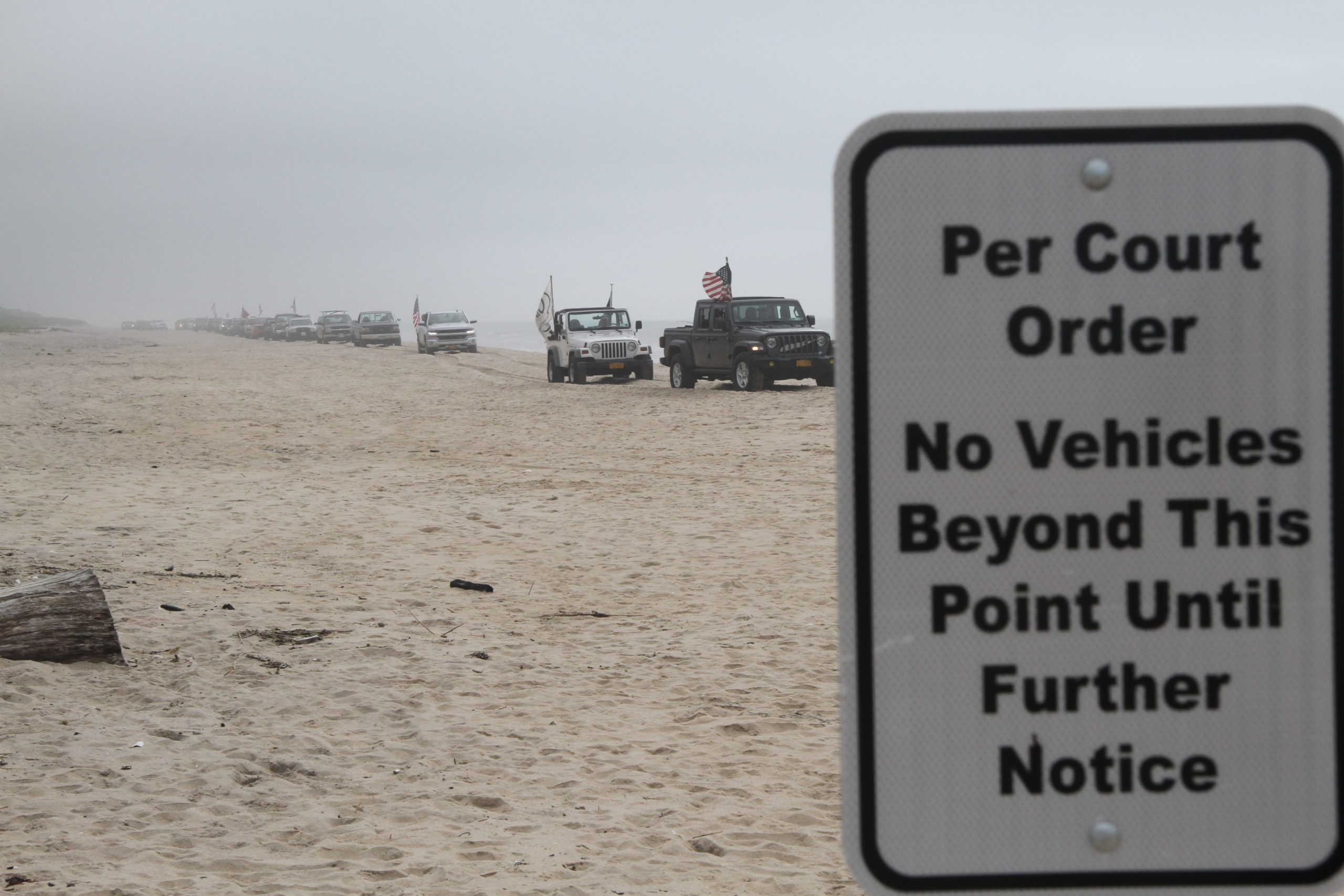 After a court ruled that nearly a mile of beach in Amagansett is privately owned, East Hampton Town lawmakers are considering seizing ownership of the sand via eminent domain.