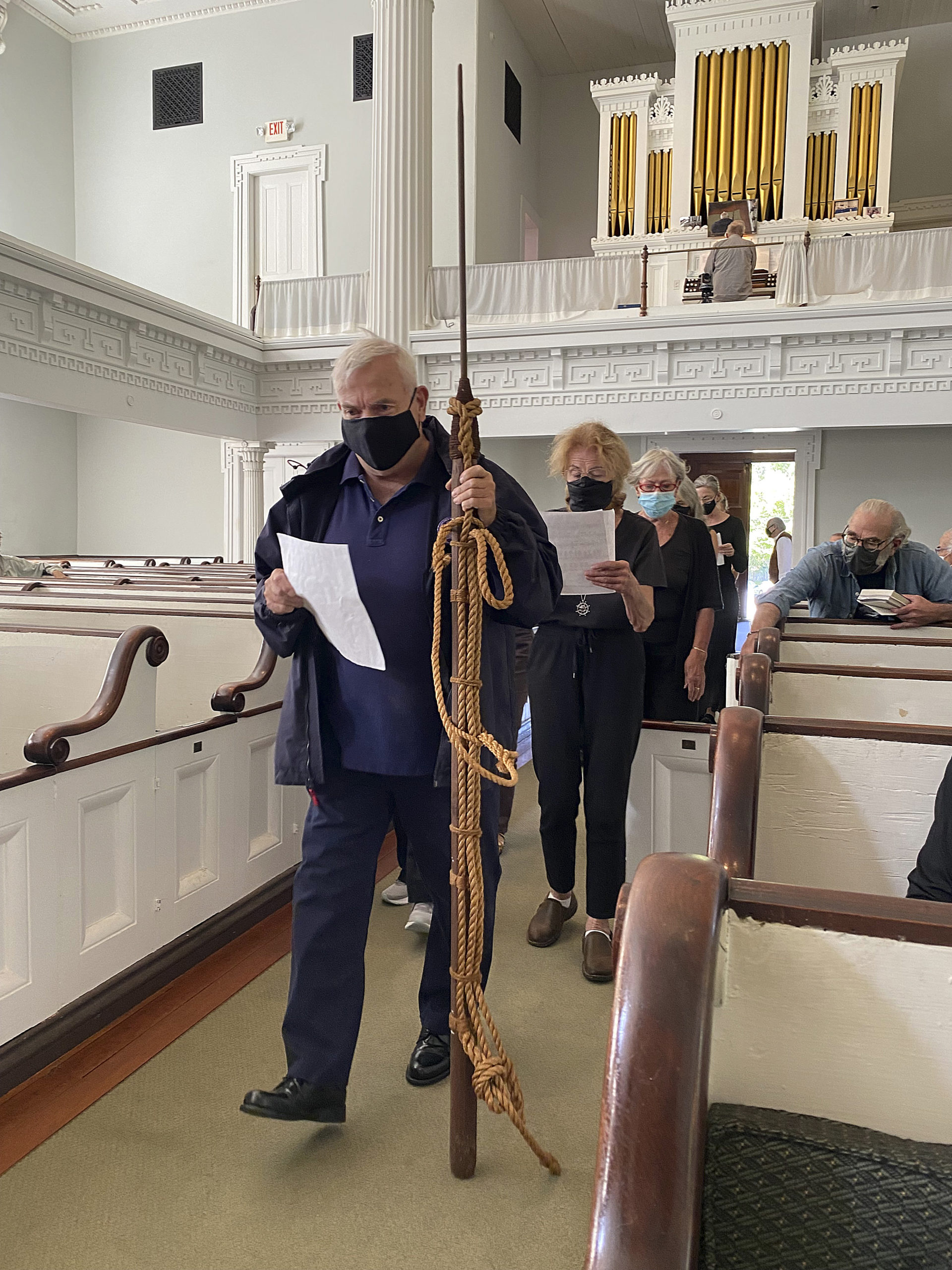 Members of the Hamptons Choral Society enter the Old Whalers Church for the Moby Dick Marathon on Friday afternoon.  DANA SHAW