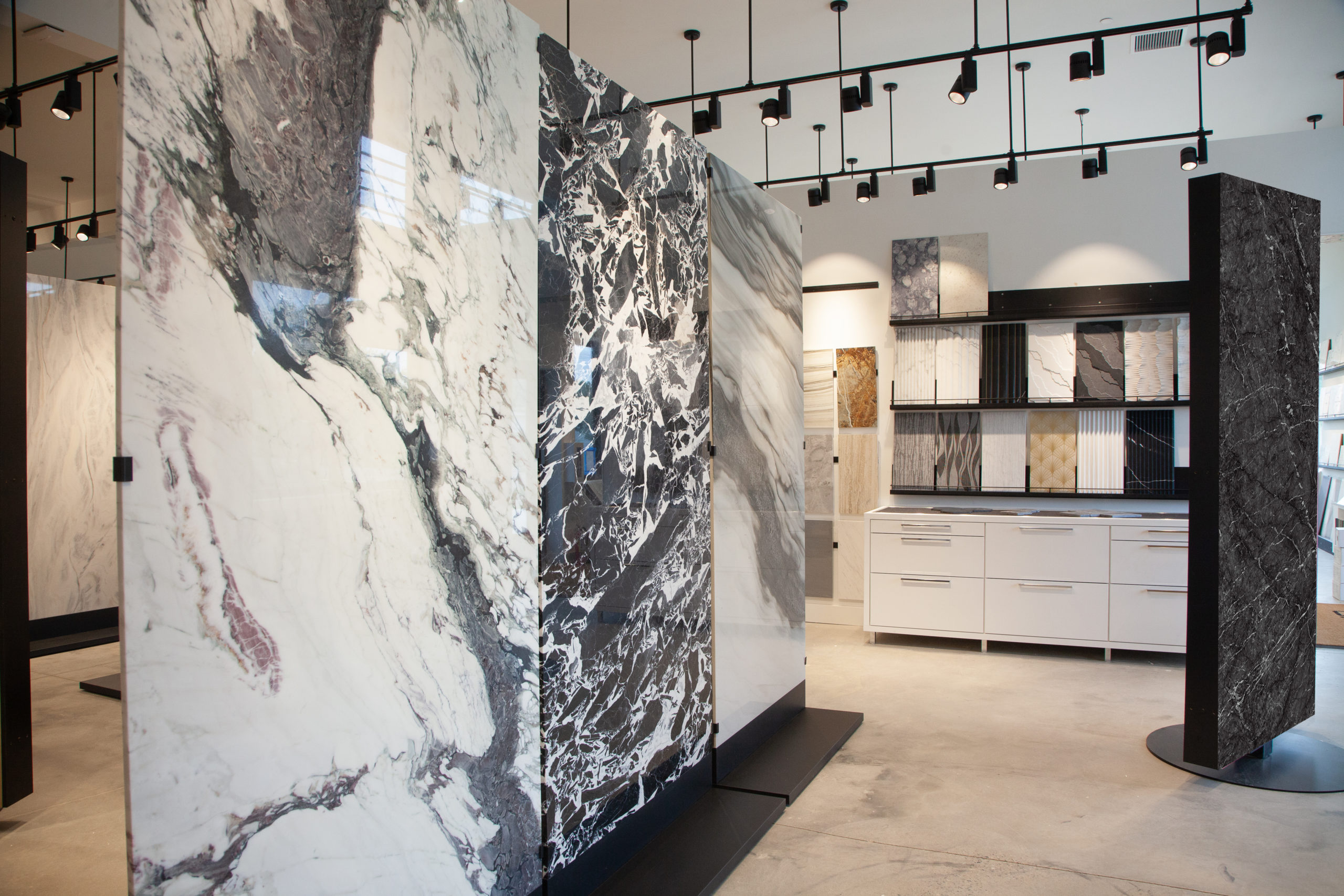Large-scaled porcelain slabs give clients a better sense of how the product will look in their home.