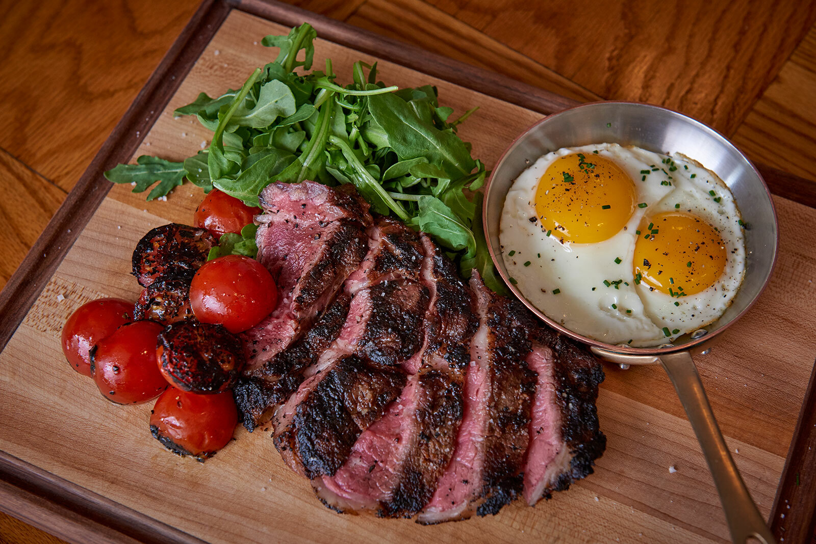 Main Street Tavern's grilled hanger steak with crispy fingerling potatoes and sunny side up eggs.