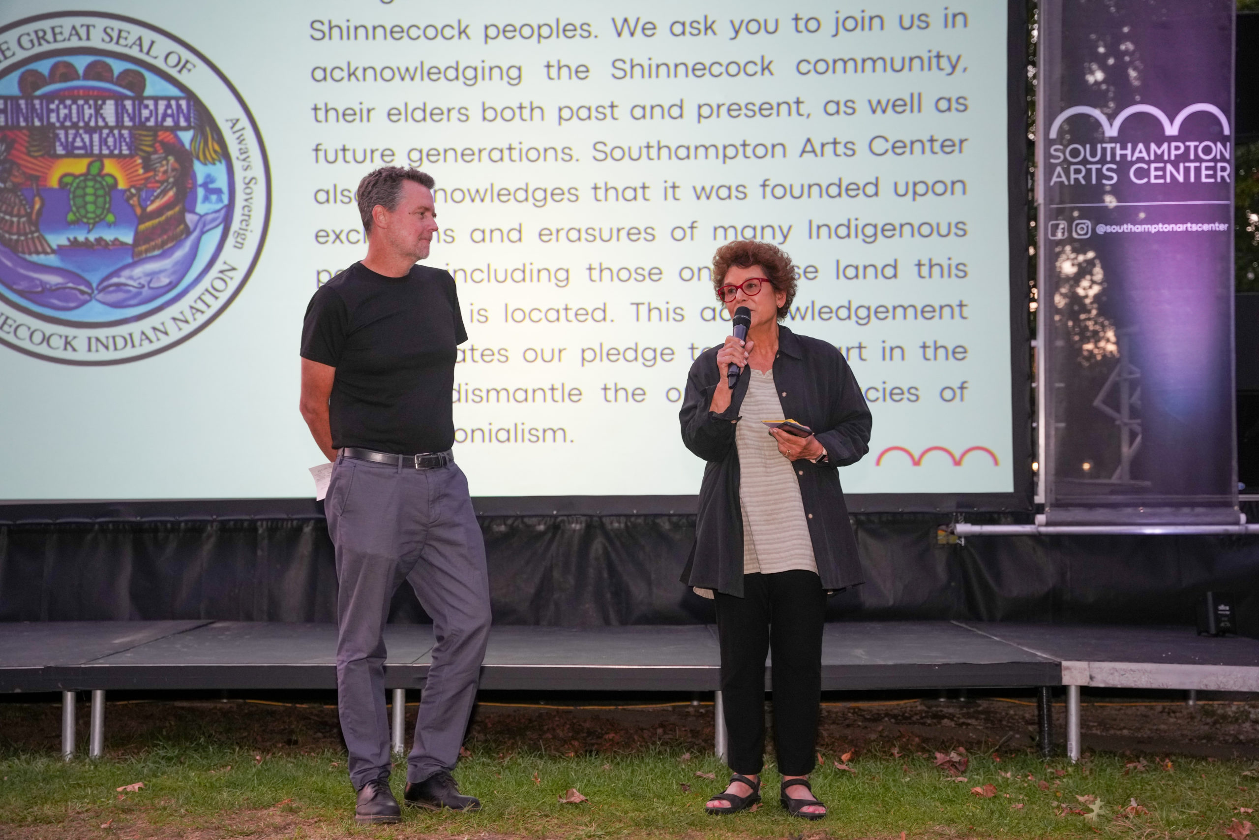 Tom Dunn, executive director of the Southampton Arts Center, left, and Jacqui Lofaro, executive director of Hamptons Doc Fest, open Friday night's festivities.