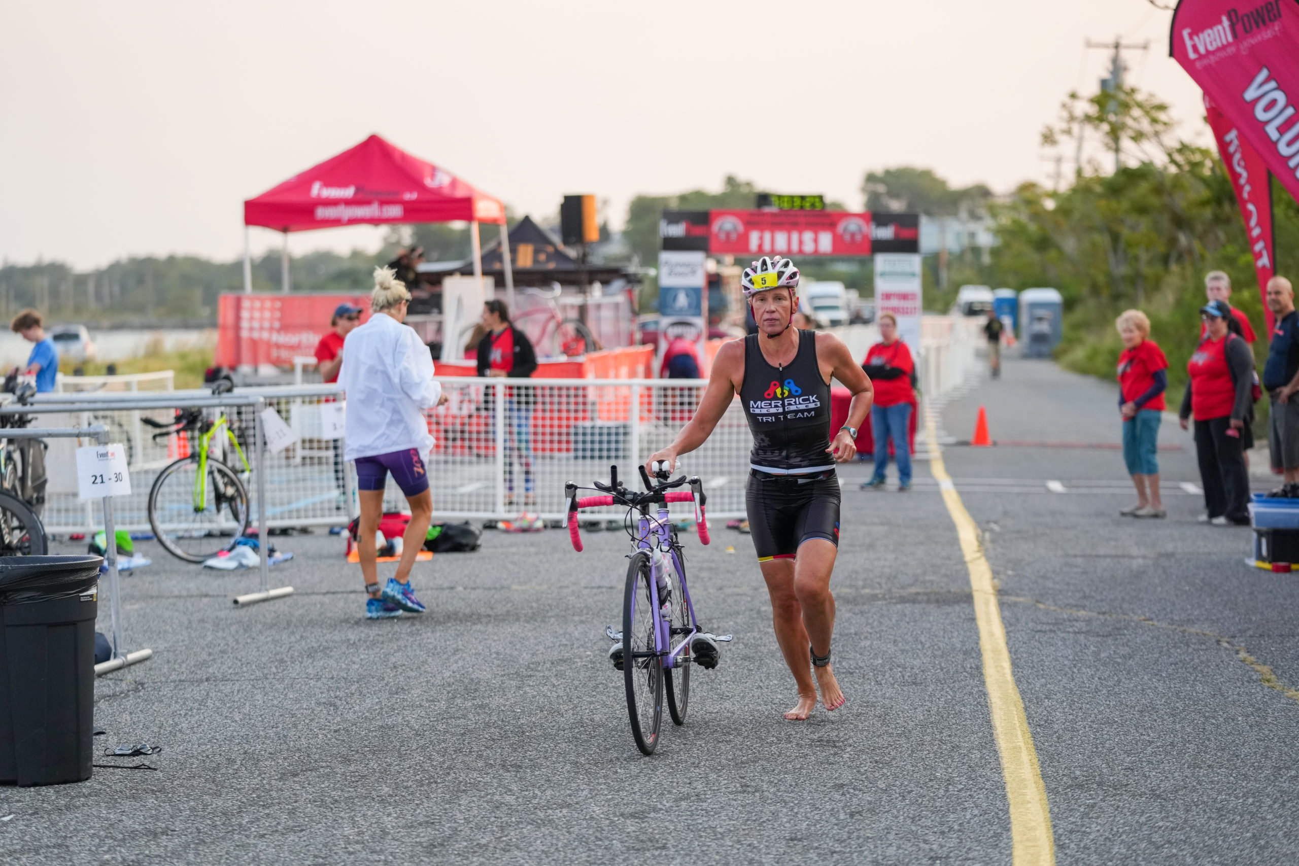 Magdalena Stovickova transitions from the swim to the bike.