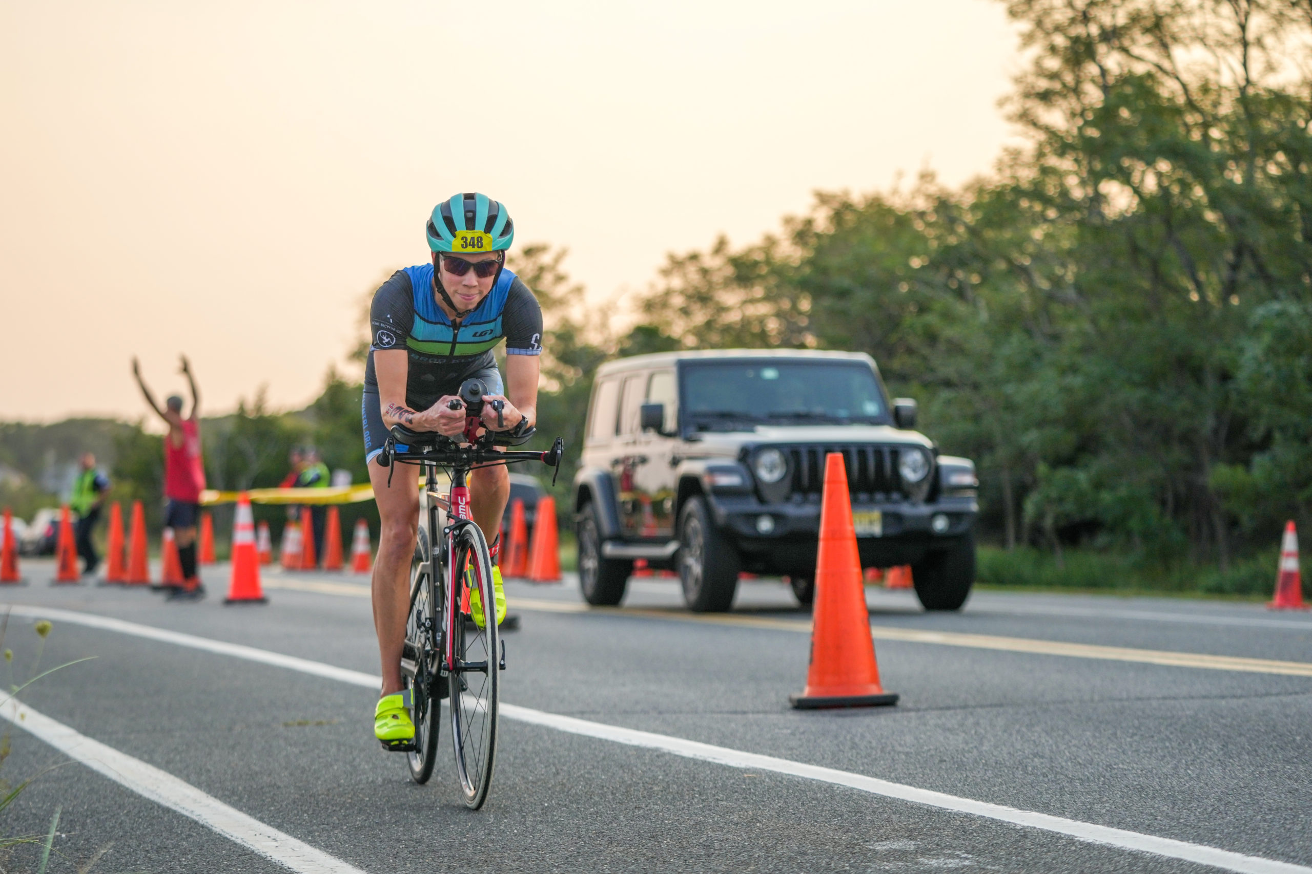 Anna Carlson rides by in the bike portion.