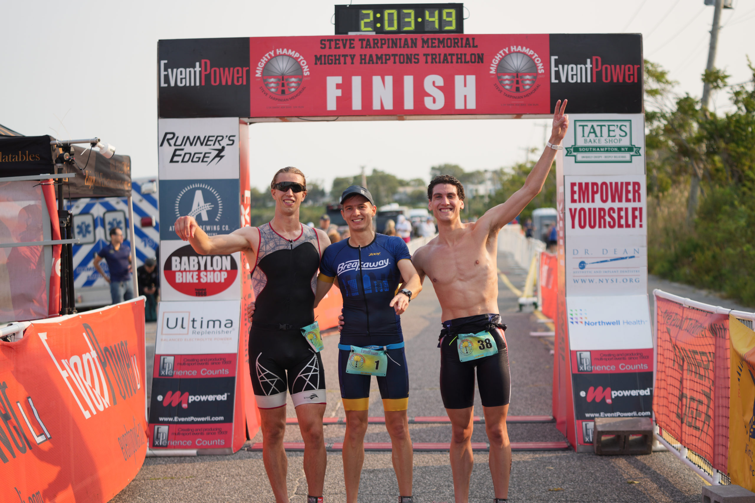 The top three finishers of Sunday morning's Mighty Hamptons Triathlon, from left, Dylan McMurrer, Roman Fedosieiev and Jason Quinn.