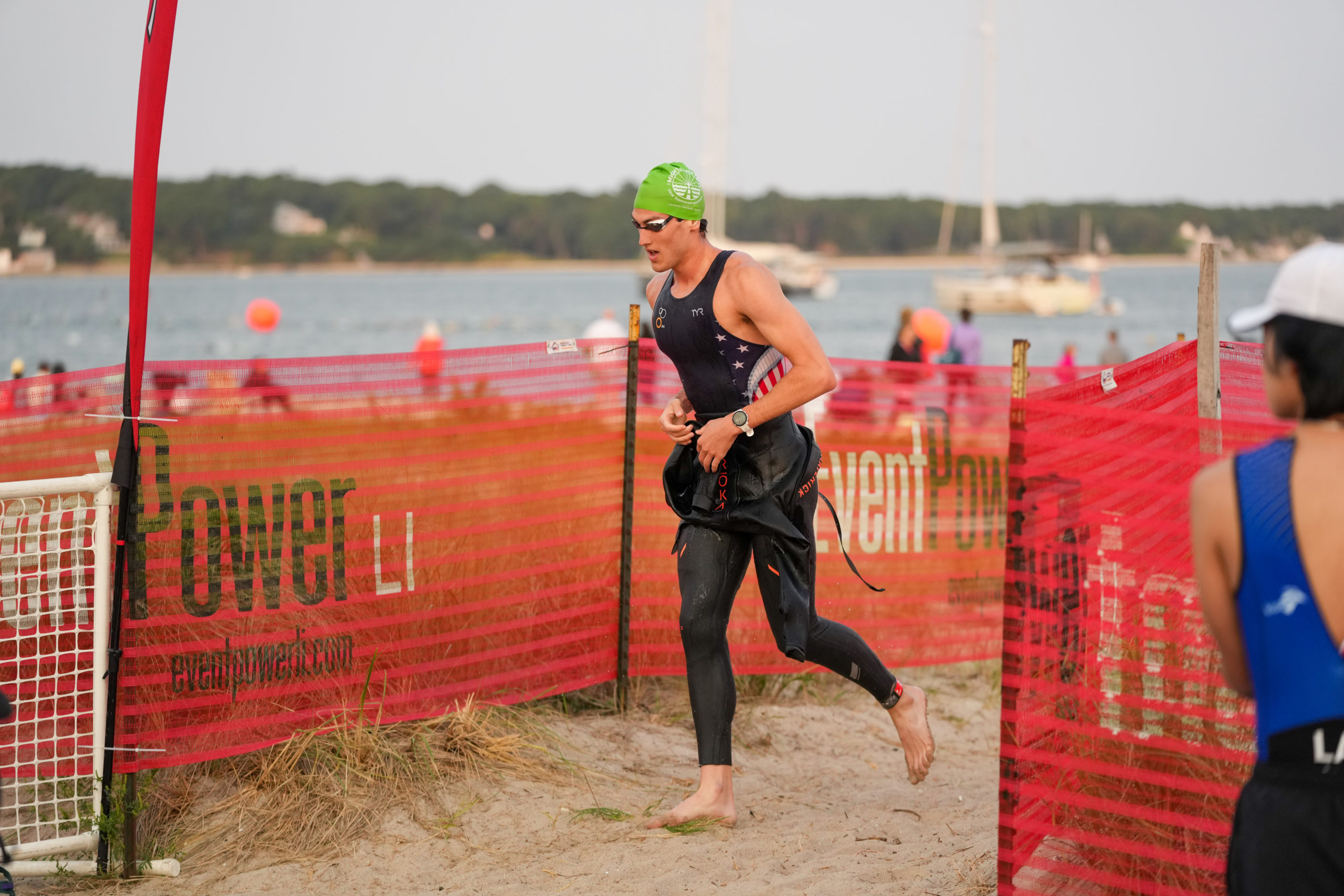 An athlete transitions from the swim to the bike portion of the triathlon.