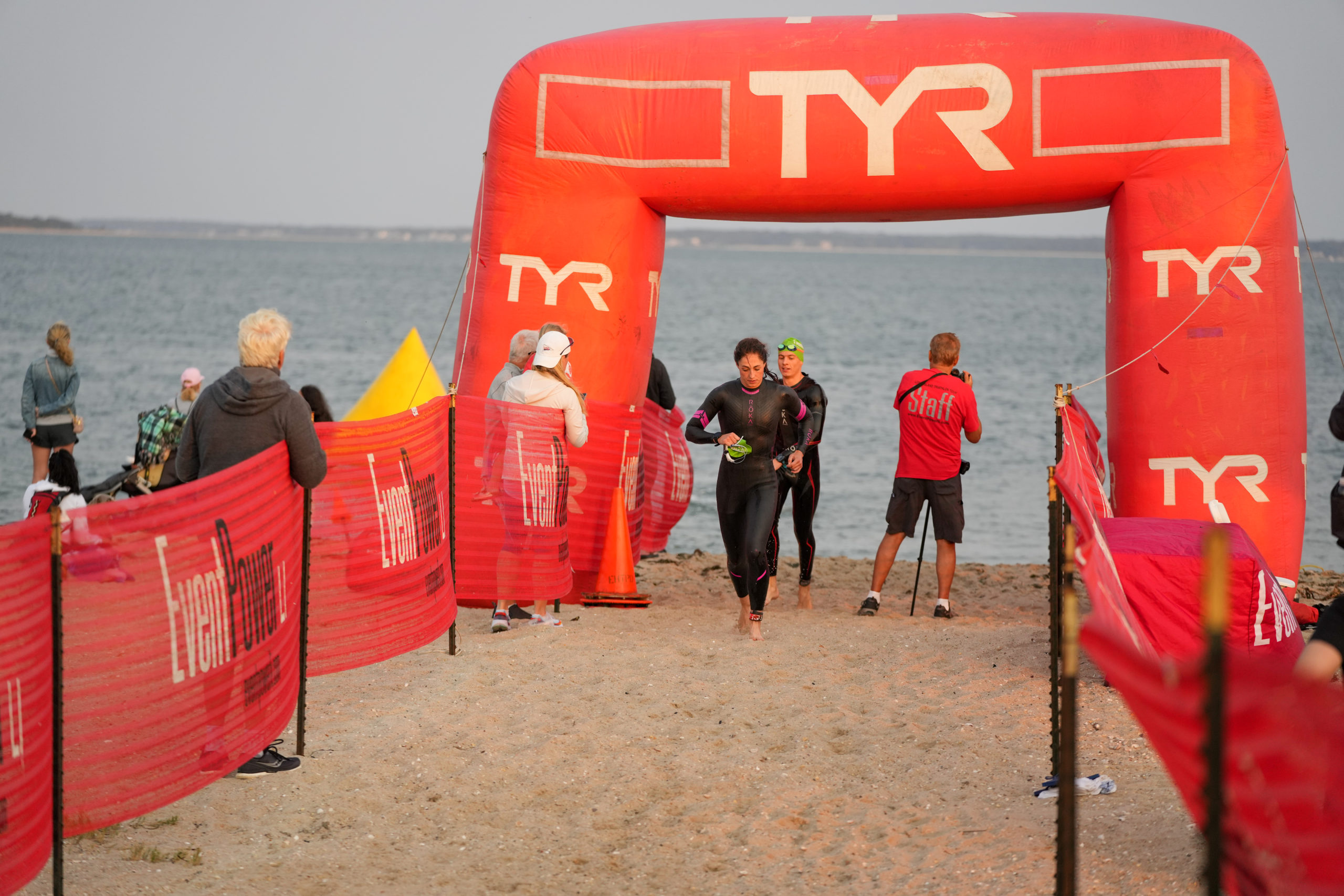 Swimmers head out of the water and head to the transition area.