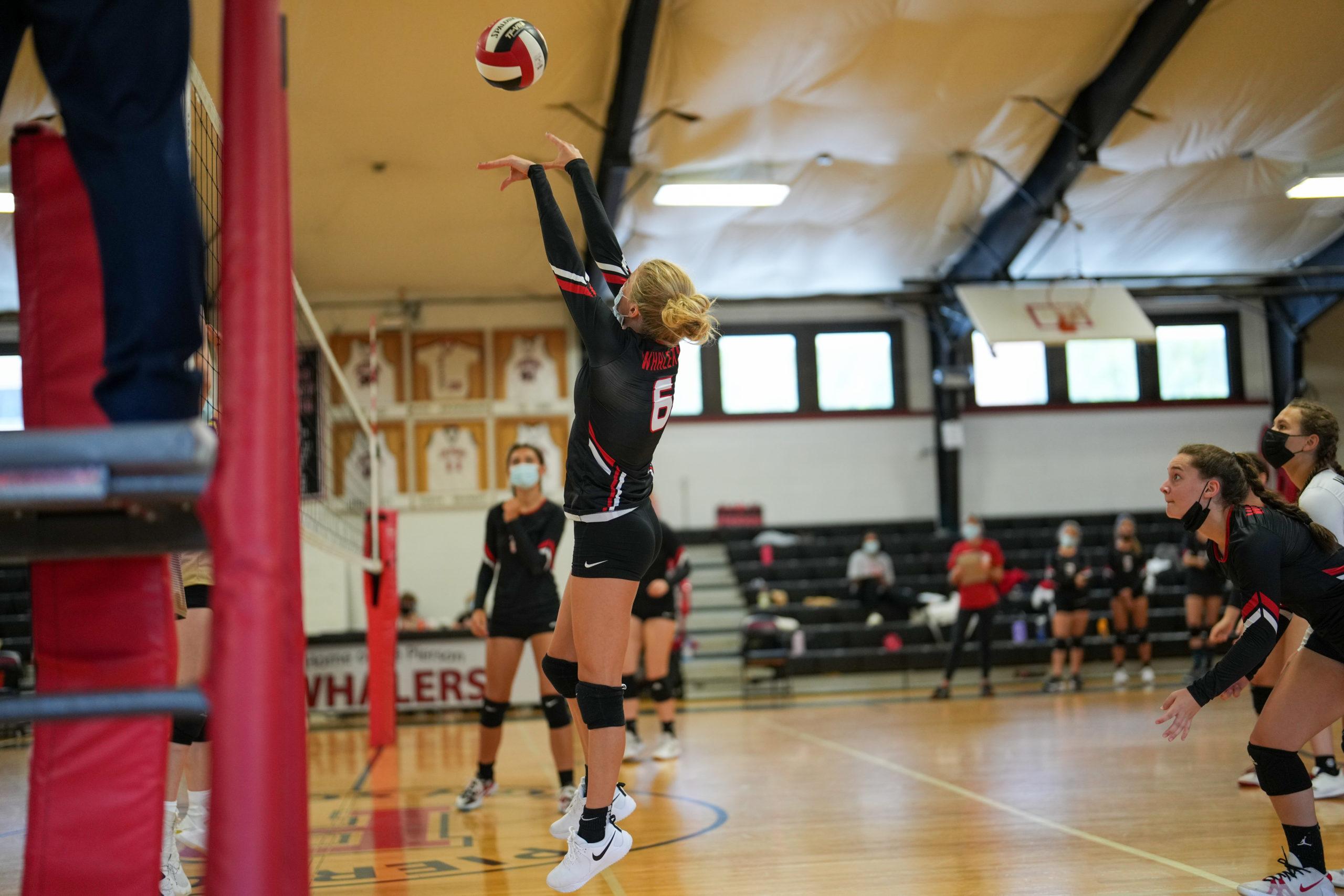 Pierson junior Sadie Latanzio pushes the ball back over the net.