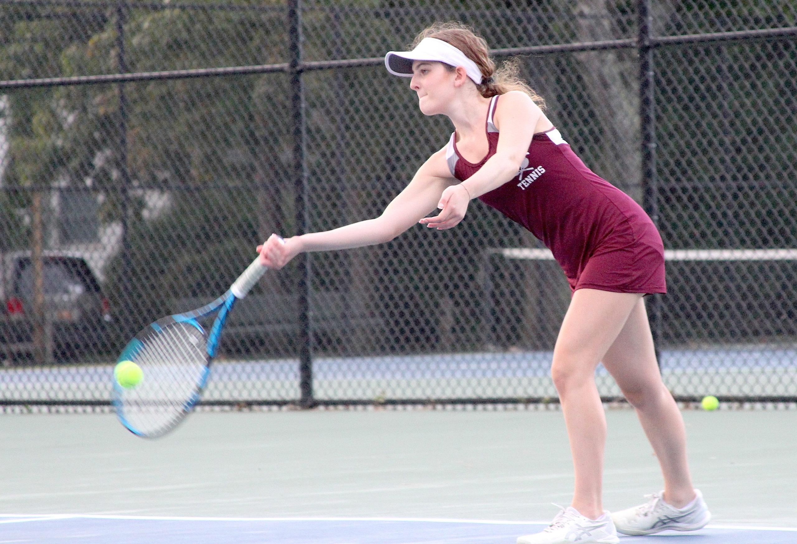 Pierson sophomore Rachel Monaco returns the ball for her East Hampton second doubles team. DESIRÉE KEEGAN