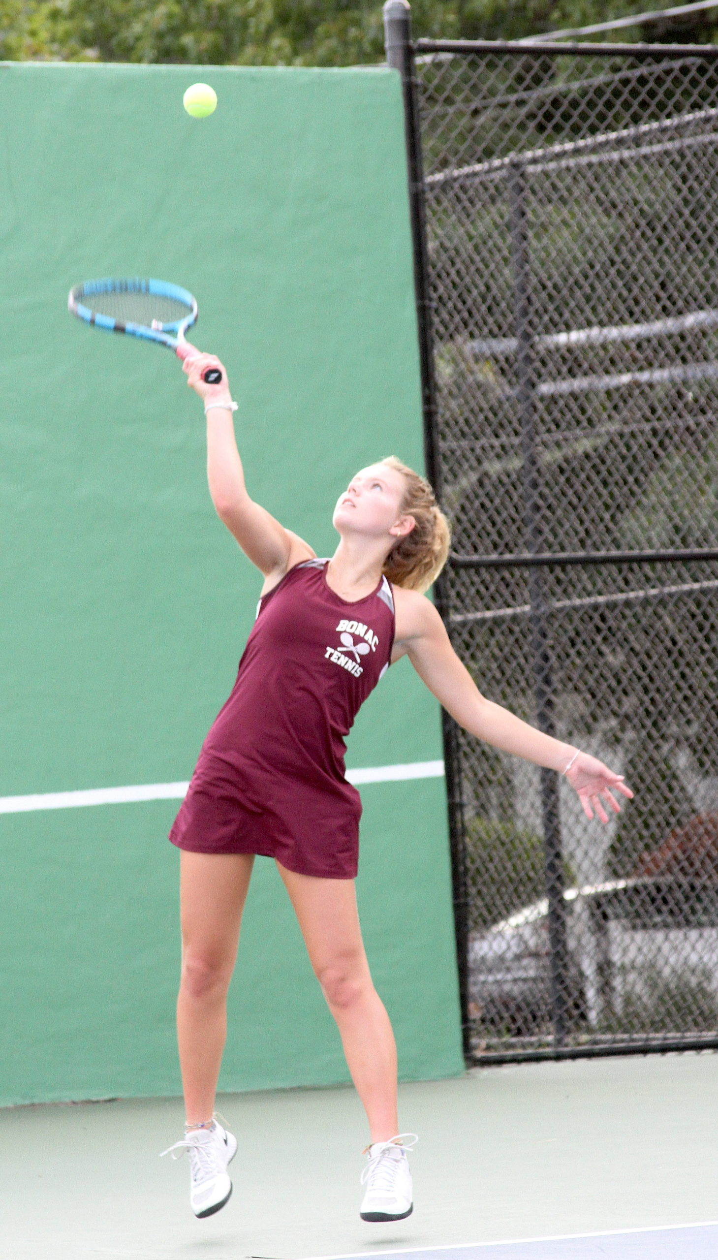 East Hampton sophomore Lyla Wilson serves up an ace at No. 4 singles. DESIRÉE KEEGAN
