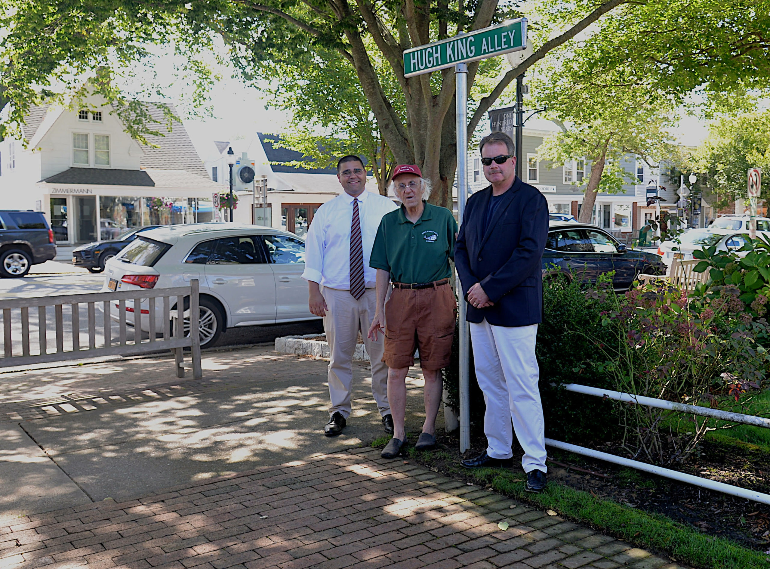 Town Crier and historian Hugh King, with East Hampton Village Mayor Jerry Larsen and Village Administrator Marcos Baladron, was honored with the dedication of the alley between Newtown Lane and the Schenck parking lot in his name this week, ahead of the village's centennial celebrations.