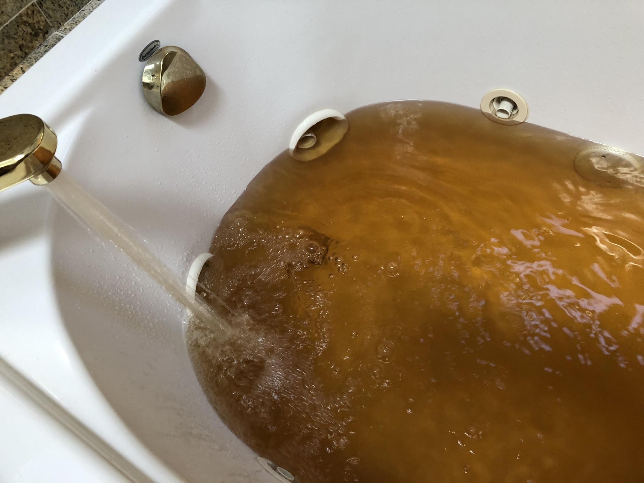 Rusty brown water is an all too familiar sight in Hampton Bays.