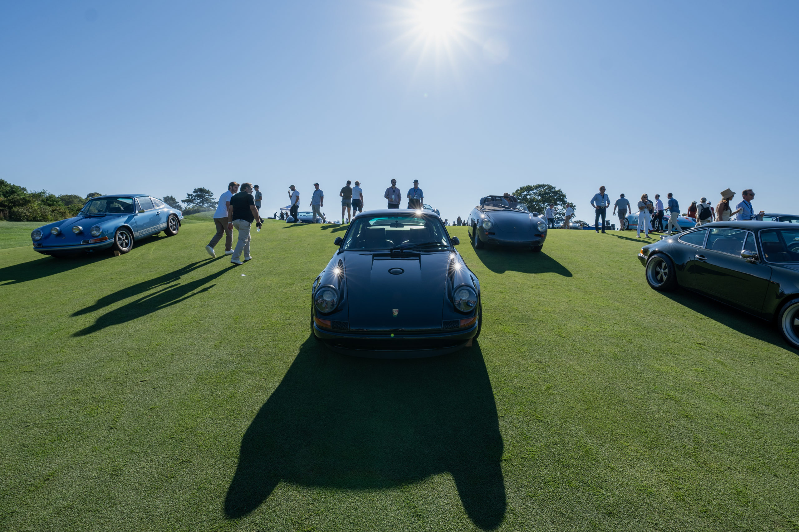 A number of automobiles, both classic and modern, took over The Bridge Golf Course on Saturday, the fifth annual event.