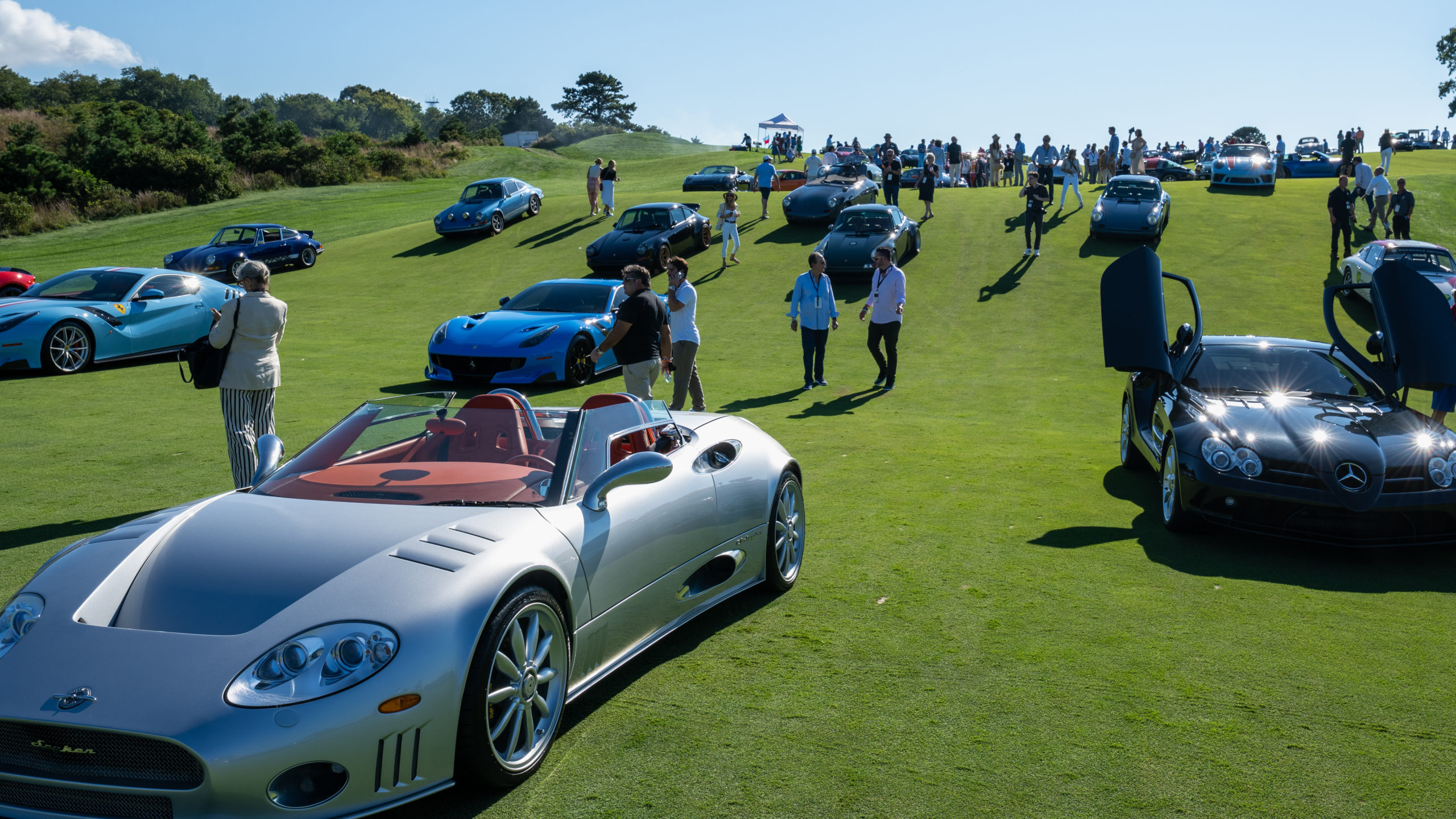 A number of automobiles, both classic and modern, sprawled The Bridge golf course on Saturday, the fifth annual event.