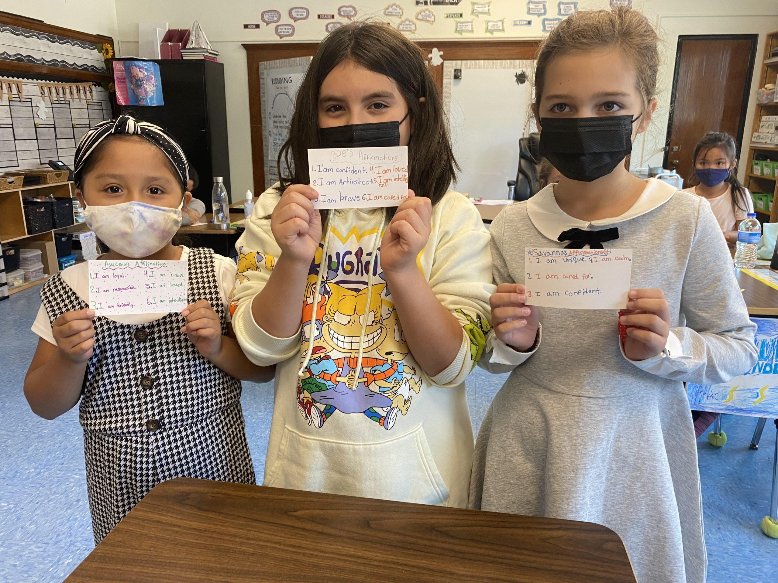 Bridgehampton School fourth-graders, left to right, Asucena Dominguez-Ramos, Zoe Urgiles and Savanna Lillie, with their positive affirmation cards.
