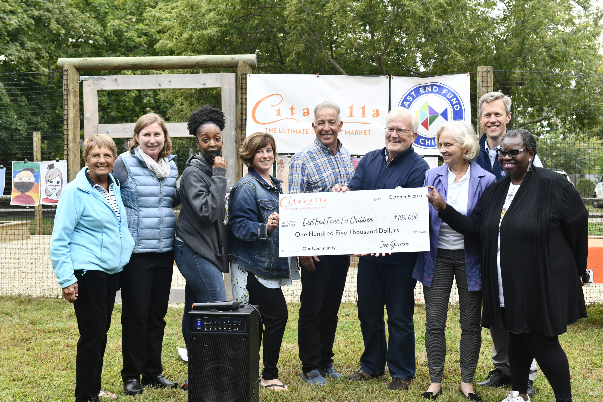 """Citarella owner Joe Gurrera presented the East End Fund for Children with a check for $105,000 at the Bridgehampton location on October 5. The funds are  the final tally from Citarella's  summer's shopping RoundUp fundraiser, which was held from  July 30 through Labor Day which encouraged shoppers to """"roundup"""" at the end of their purchase.  Left to right,  Mary Topping of the Southampton Youth Association (SYA); Rebecca Taylor from Project Most; Alicia Austin of SYA; Theresa Roden from i-Tri; Citarella owner Joe Gurrera; Tim Frazier of the The Eleanor Whitmore Early Childhood Center; Loretta Davis of the Retreat; Stephen Long of CMEE and Bonnie Cannon of the (The Bridgehampton Child Care & Recreational Center.   DANA SHAW"""