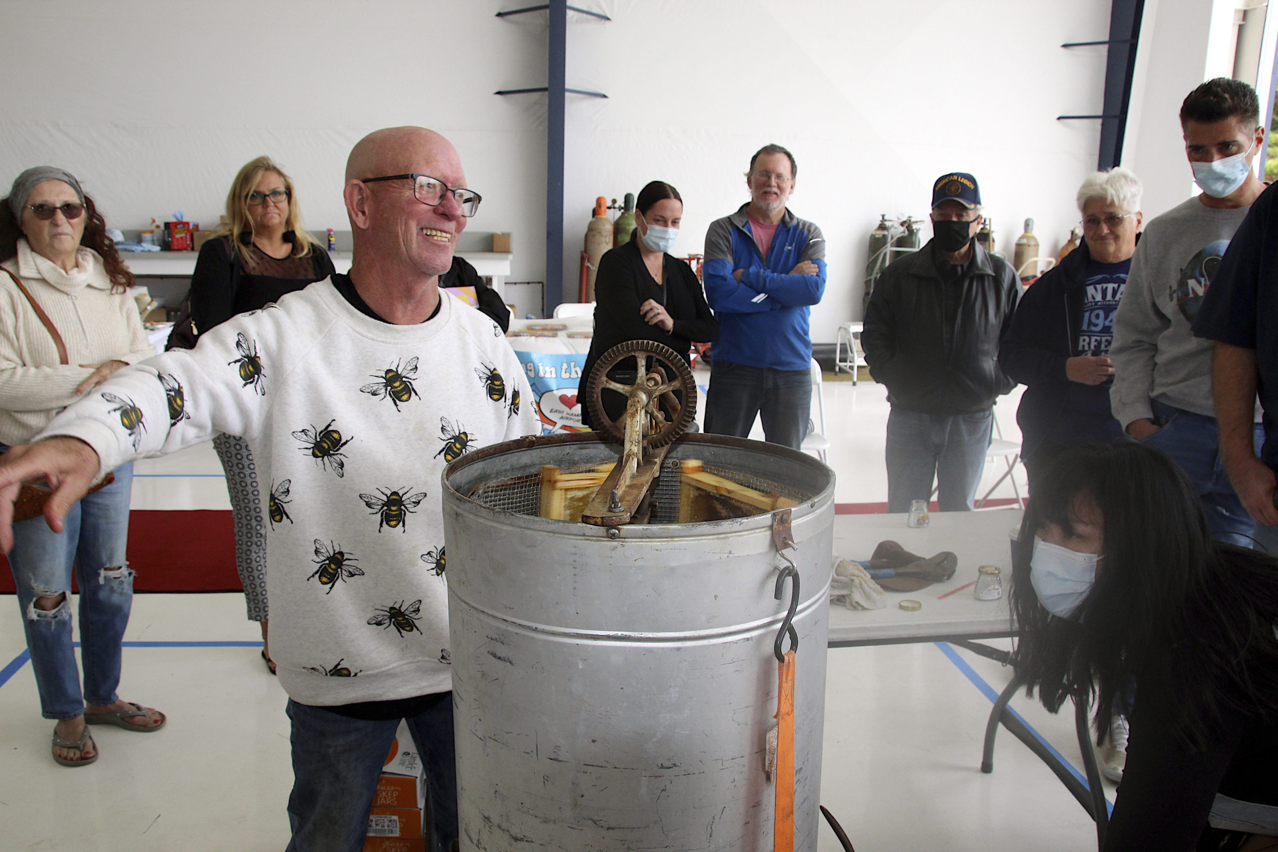 Beekeeper Chris Kelly at the Honey Harvest Fest hosted by Sound Aircraft Services at the East Hampton Airport.  KYRIL BROMLEY