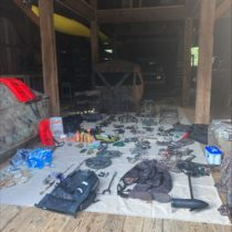 Two hunters outfitted with motion-activated cameras and hundreds of pounds of provisions, camping gear and hunting equipment were discovered on the private game preserve Robins Island last week.