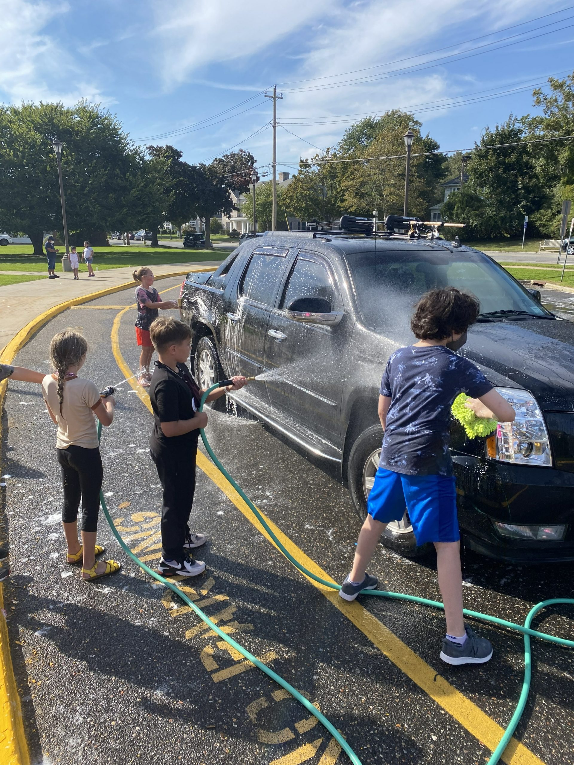 Students from Southampton Elementary School and Southampton Intermediate School teamed up with the Southampton High School field hockey team and the Southampton Rotary Club to hold a car wash fundraiser on October 2 for Lucia's Angels, a nonprofit breast cancer foundation. The car wash yielded $1,950 for the organization.