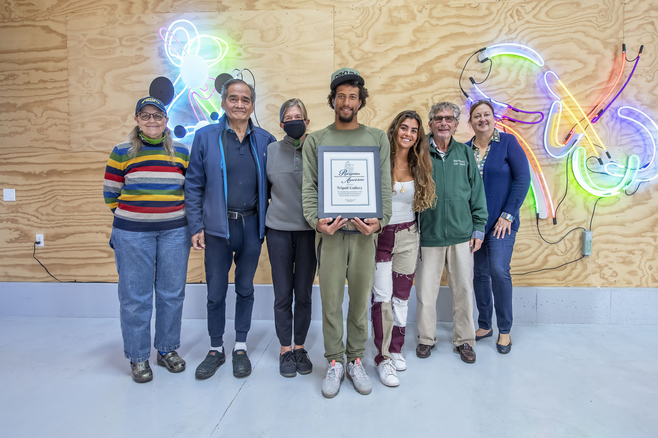 , Tripoli Patterson of the Tripoli Gallery was presented with the 2021 annual Business Community Award from the Wainscott CAC on Saturday. Left to right, Barbara D'Andrea, Philip Young, Carolyn Logan-Gluck, Tripoli Patterson, Olivia La Manna, Dennis D'Andrea and Lori Ann Czepiel.       MICHAEL HELLER
